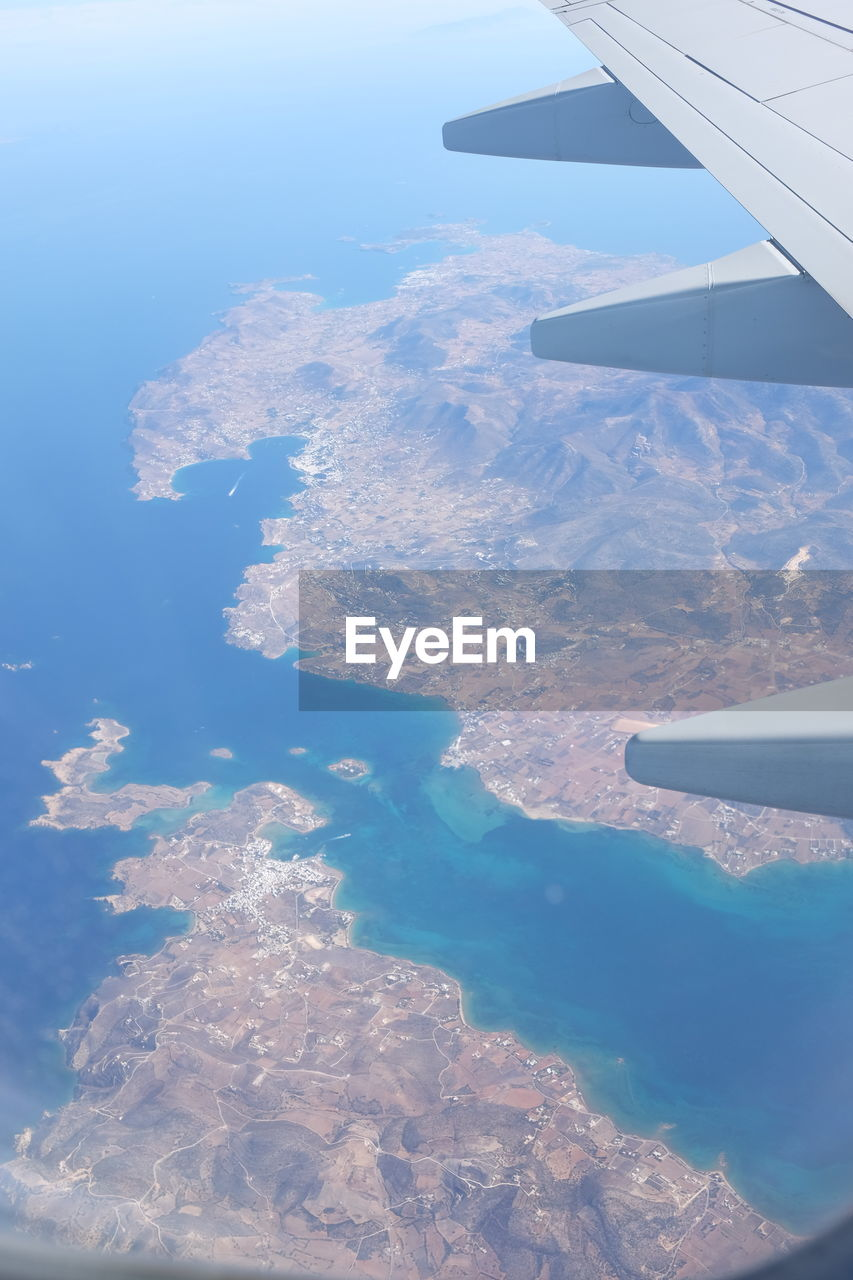 Aerial Shot Earth Santorini, Greece Aerial View Aircraft Wing Airplane Airplane Wing Beauty In Nature Day Flying Greece Island Journey Landscape Mid-air Nature No People Outdoors Scenics Sky Transportation Travel View Into Land Water