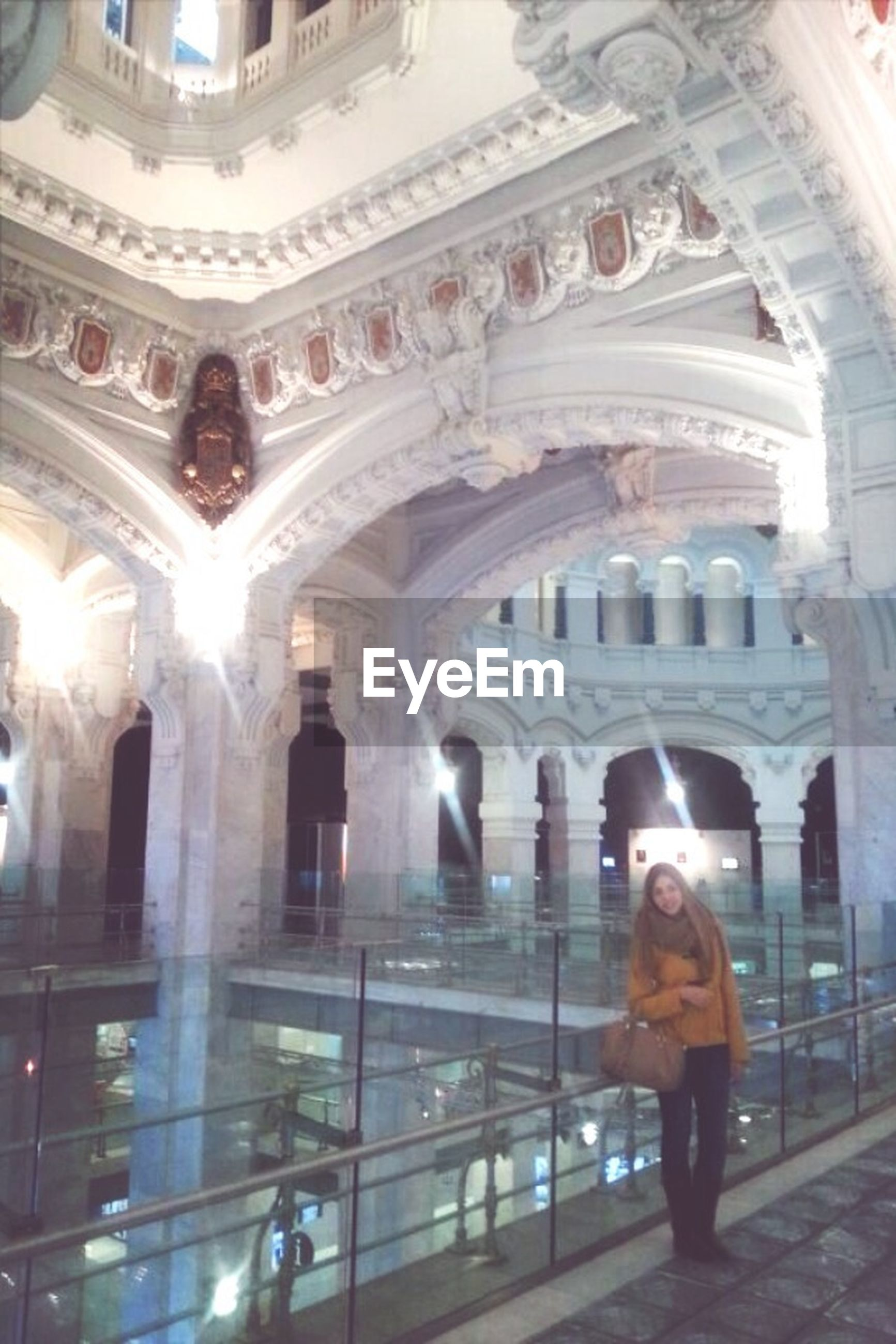 indoors, architecture, built structure, arch, place of worship, religion, lifestyles, church, spirituality, leisure activity, famous place, travel, travel destinations, ceiling, tourism, full length, men, low angle view