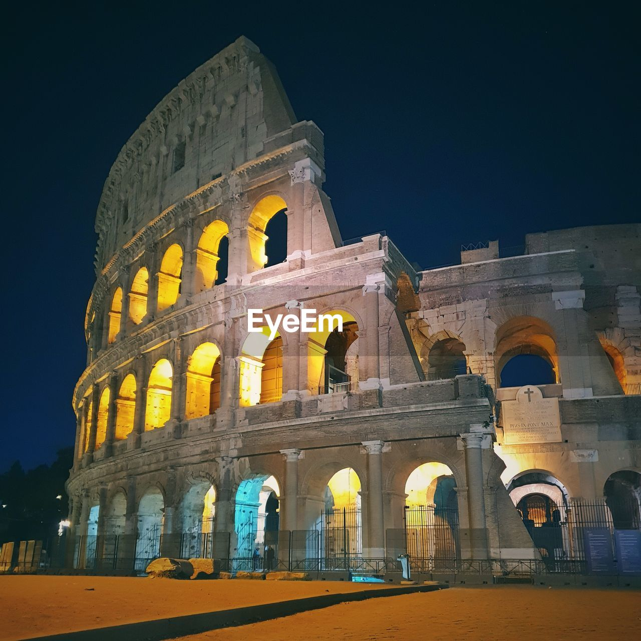 history, architecture, arch, built structure, the past, tourism, travel, travel destinations, building exterior, ancient, sky, night, amphitheater, nature, city, arts culture and entertainment, old ruin, illuminated, low angle view, ancient civilization, no people, outdoors, archaeology, arched