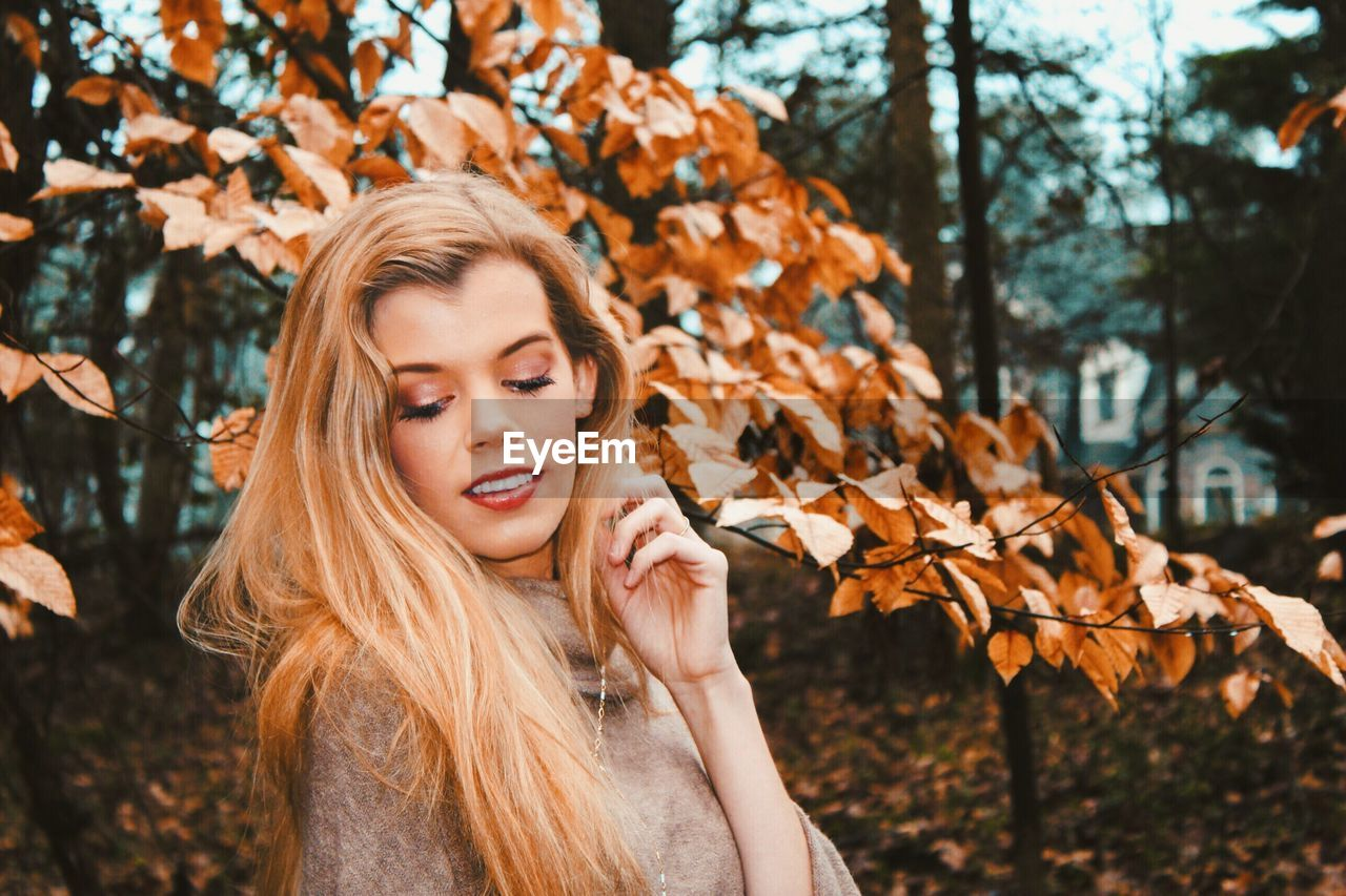 hair, one person, autumn, blond hair, tree, young adult, plant part, long hair, headshot, leaf, young women, portrait, hairstyle, women, beautiful woman, nature, real people, change, beauty, outdoors, teenager, leaves