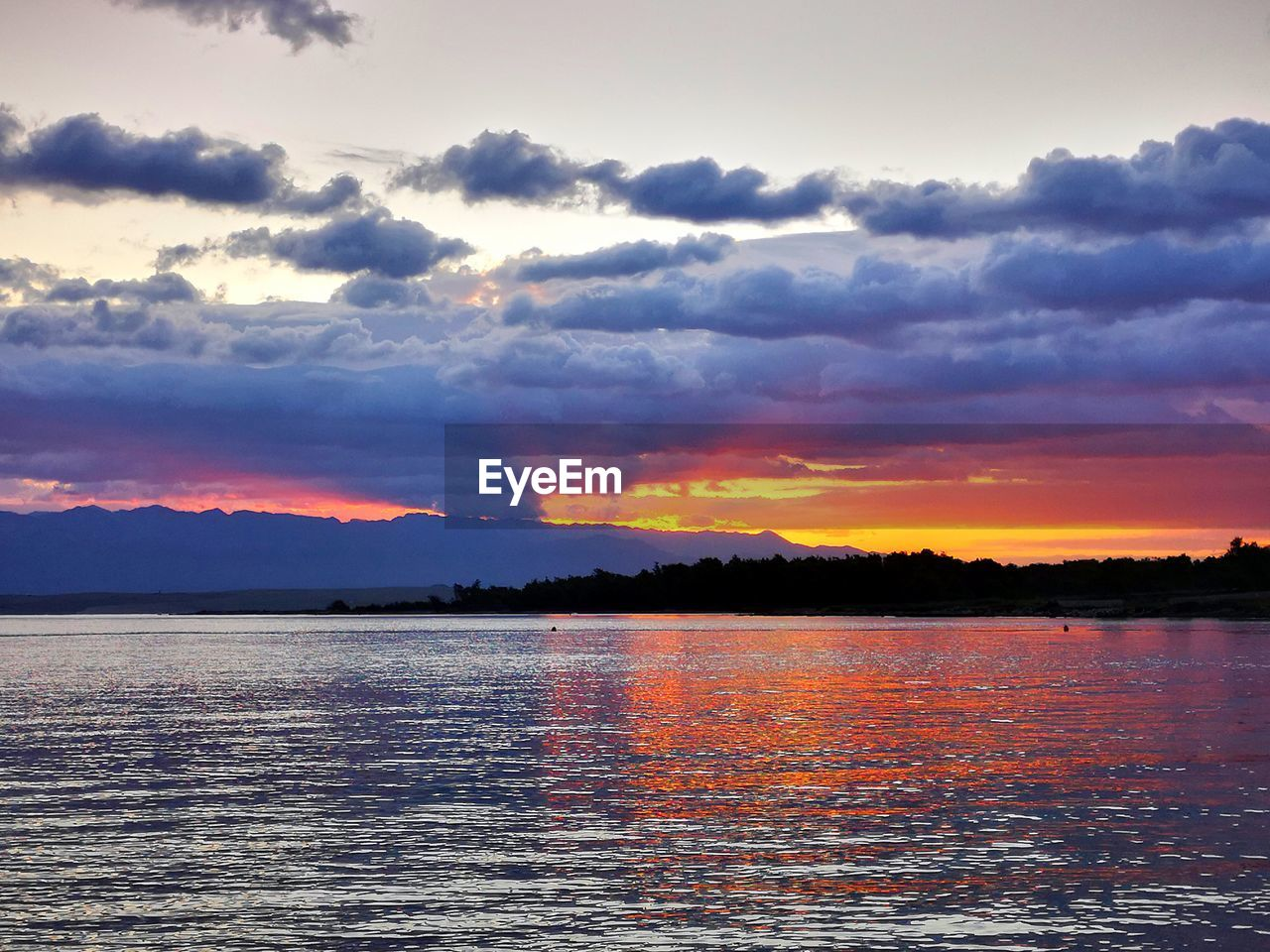sky, cloud - sky, sunset, scenics - nature, beauty in nature, water, tranquil scene, tranquility, orange color, waterfront, no people, idyllic, nature, lake, non-urban scene, outdoors, dramatic sky, silhouette