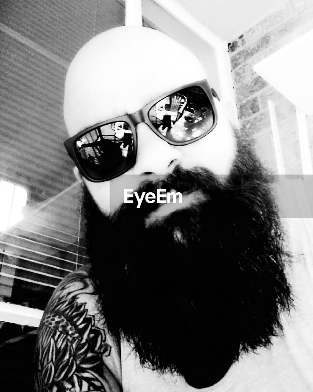 sunglasses, one person, indoors, beard, real people, young adult, headshot, portrait, human face, close-up, day, one man only, people
