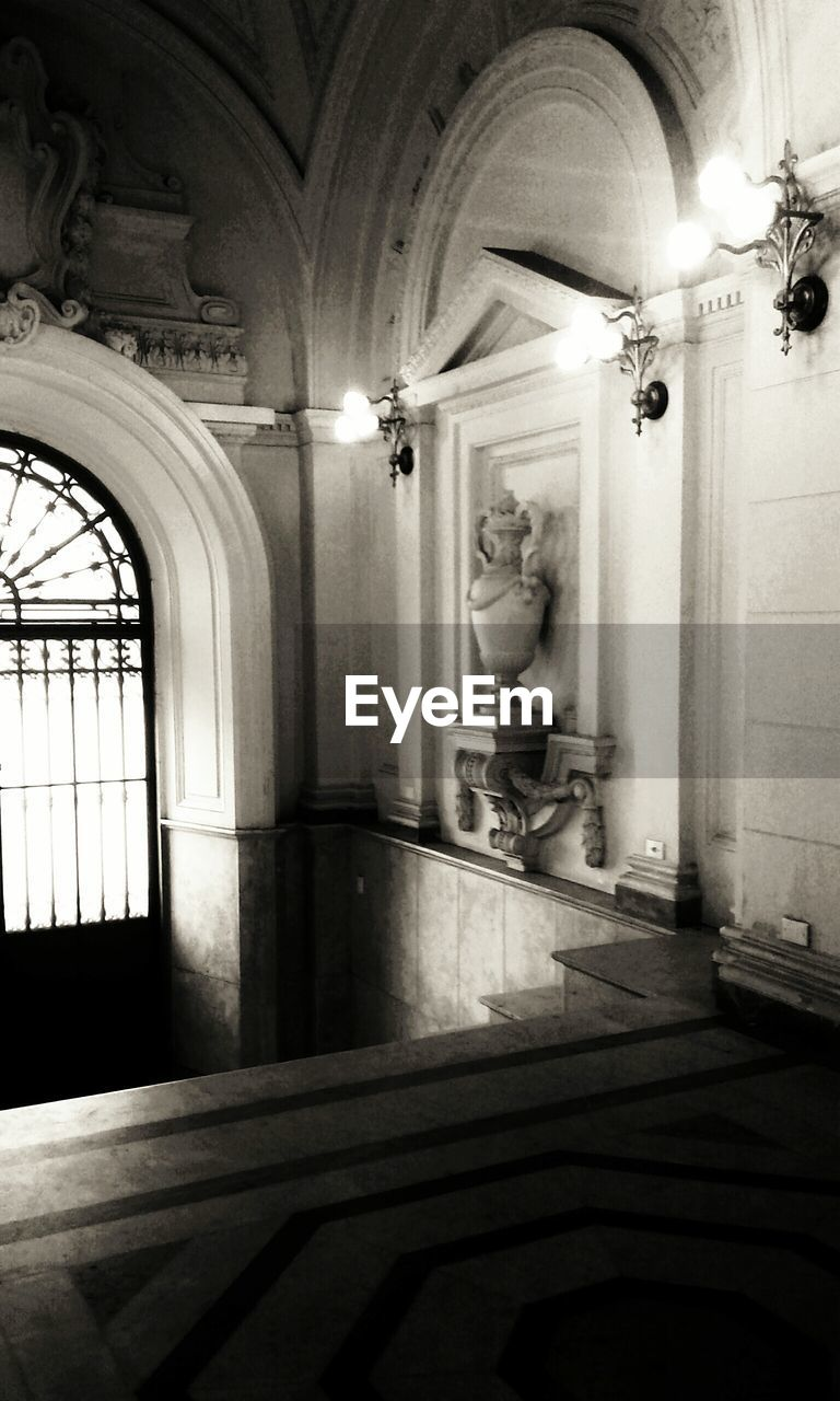 indoors, illuminated, statue, architecture, sculpture, no people, built structure, day