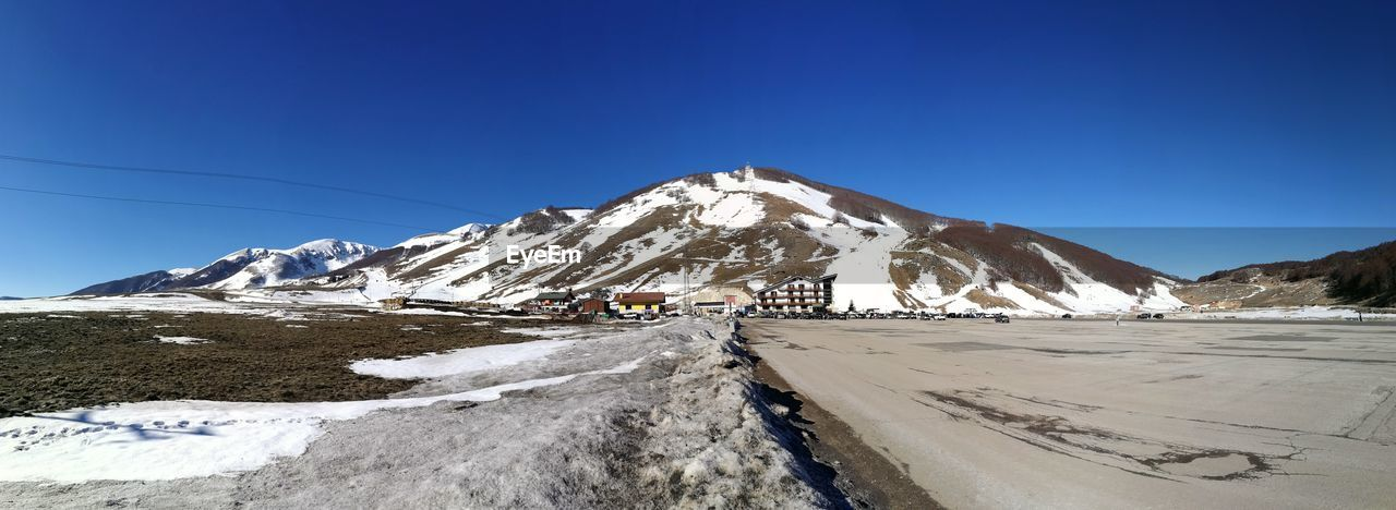 snow, cold temperature, winter, mountain, sky, scenics - nature, beauty in nature, clear sky, snowcapped mountain, blue, environment, tranquility, tranquil scene, landscape, day, nature, non-urban scene, white color, no people, mountain range, outdoors, mountain peak