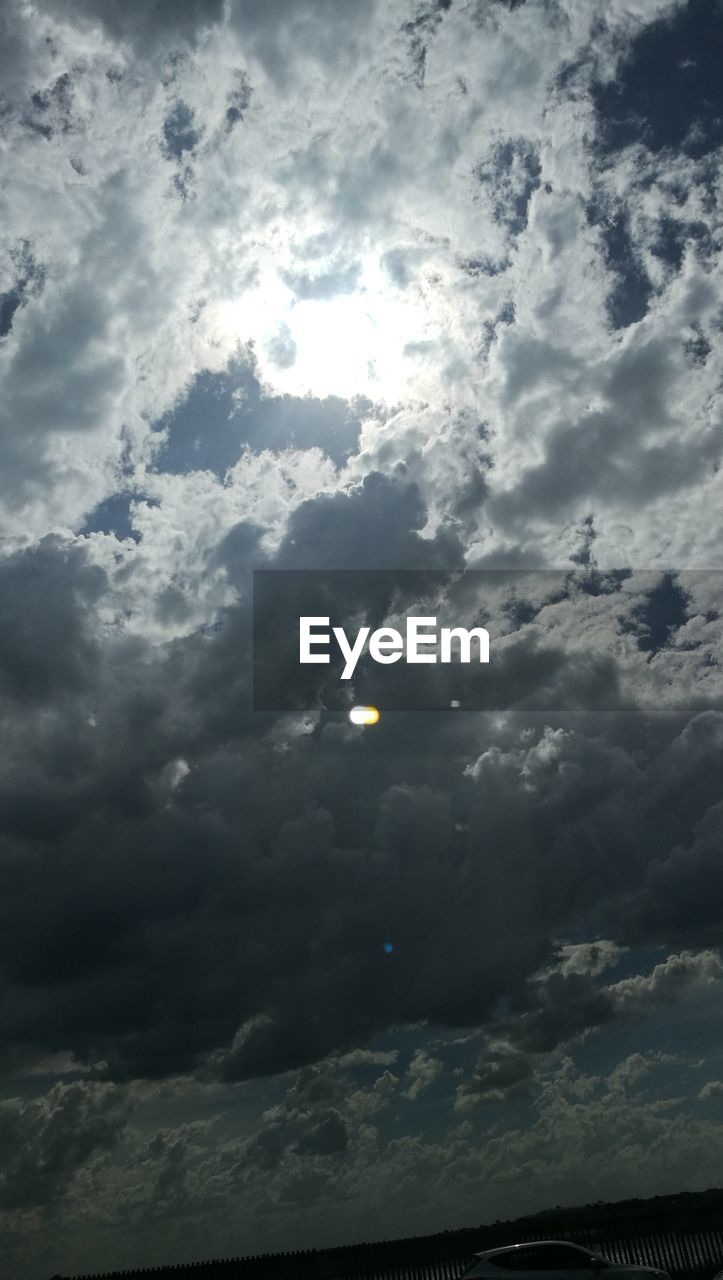 sky, cloud - sky, nature, sun, sunbeam, beauty in nature, scenics, tranquility, no people, low angle view, outdoors, sunlight, tranquil scene, moon, solar eclipse, day, astronomy