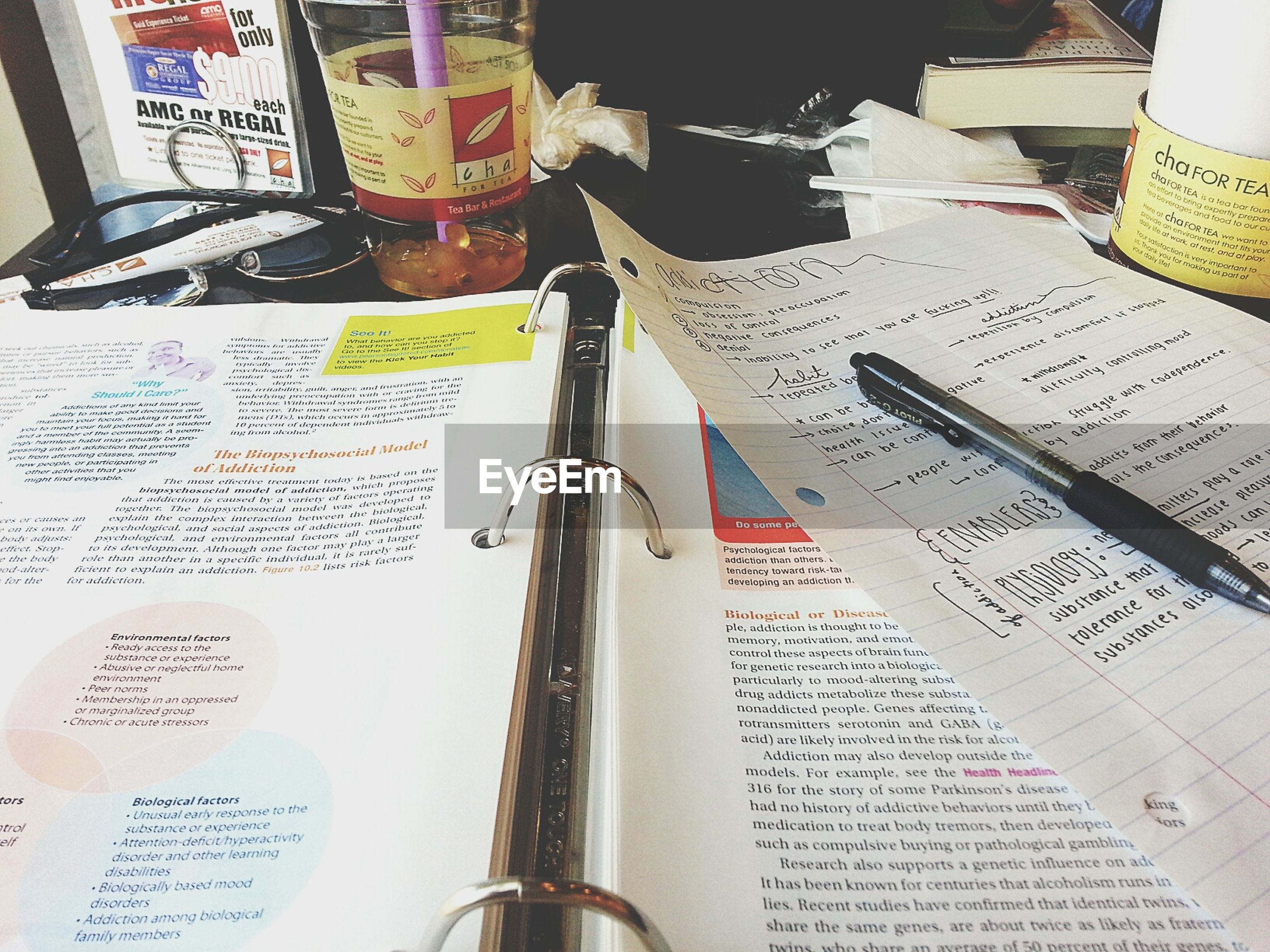 text, indoors, communication, western script, book, education, still life, paper, close-up, high angle view, pen, number, finance, table, variation, page, technology, no people, information, learning