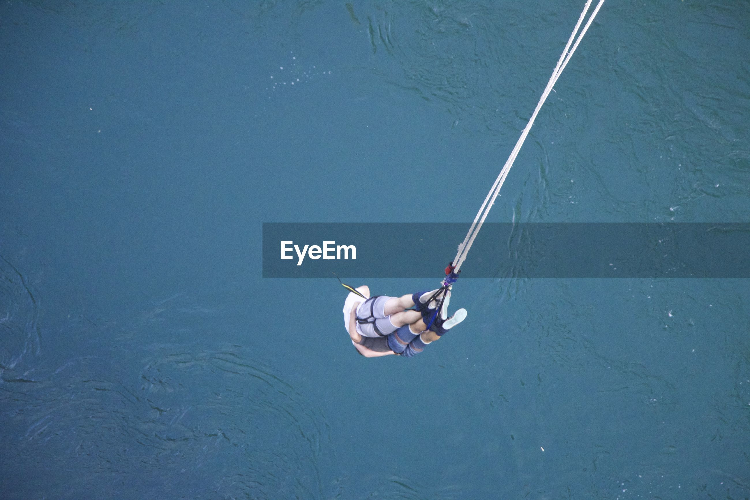 High angle view of people hanging over sea