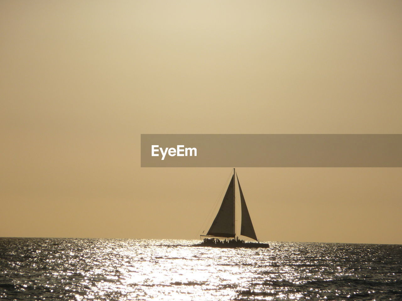 water, sea, sky, nautical vessel, copy space, transportation, sailboat, horizon over water, horizon, waterfront, mode of transportation, sunset, sailing, nature, canvas, clear sky, beauty in nature, tranquility, scenics - nature, no people, outdoors, luxury