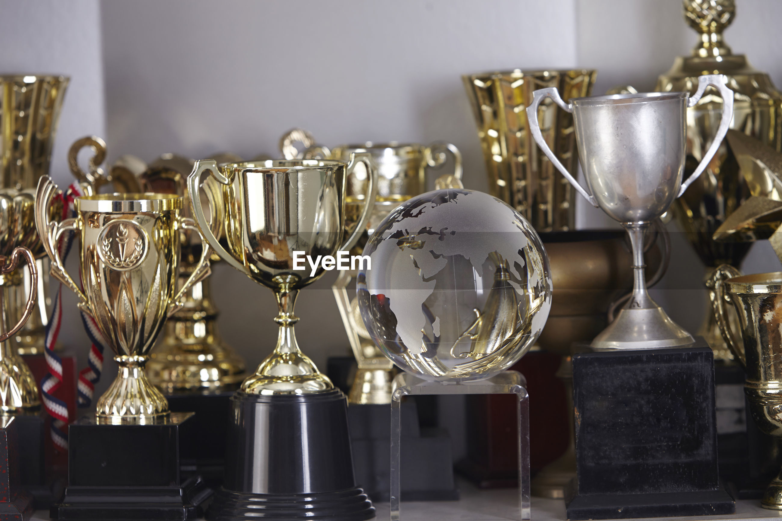 Various trophy in shelf at home