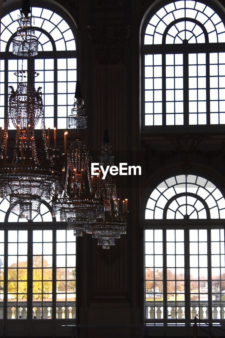 indoors, window, architecture, arch, built structure, ceiling, day, chandelier, no people, glass - material, glass, building, place of worship, lighting equipment, hanging, belief, religion, ornate, luxury, window frame