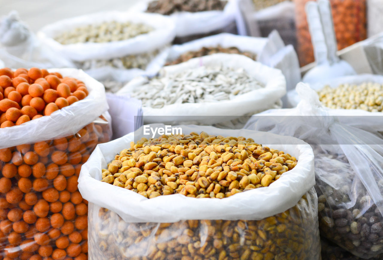 food, food and drink, wellbeing, freshness, market, healthy eating, large group of objects, still life, no people, market stall, variation, choice, for sale, focus on foreground, retail, container, abundance, raw food, close-up, bean, retail display