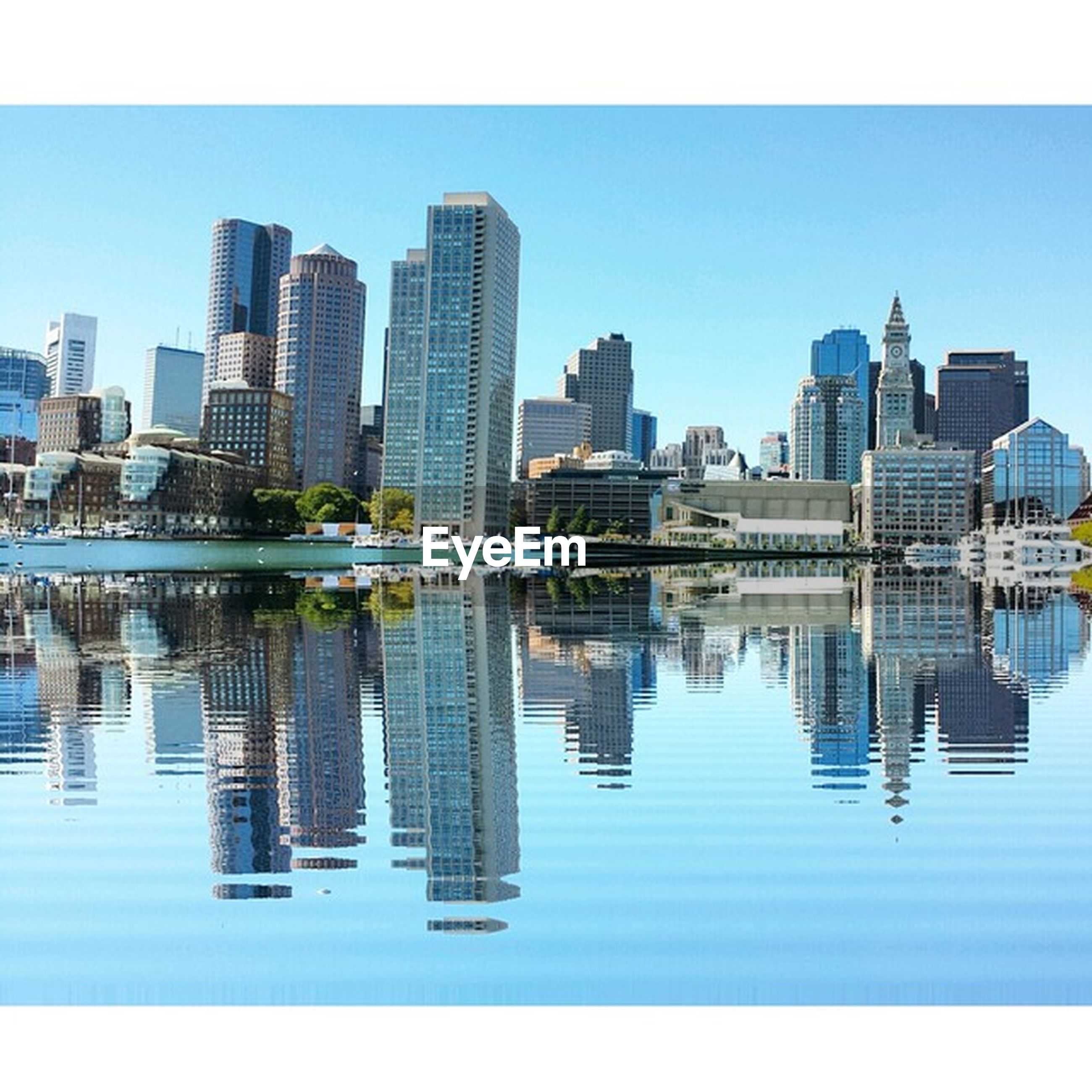 architecture, building exterior, built structure, city, water, skyscraper, reflection, waterfront, clear sky, cityscape, blue, modern, river, office building, tall - high, urban skyline, tower, building, skyline, sky