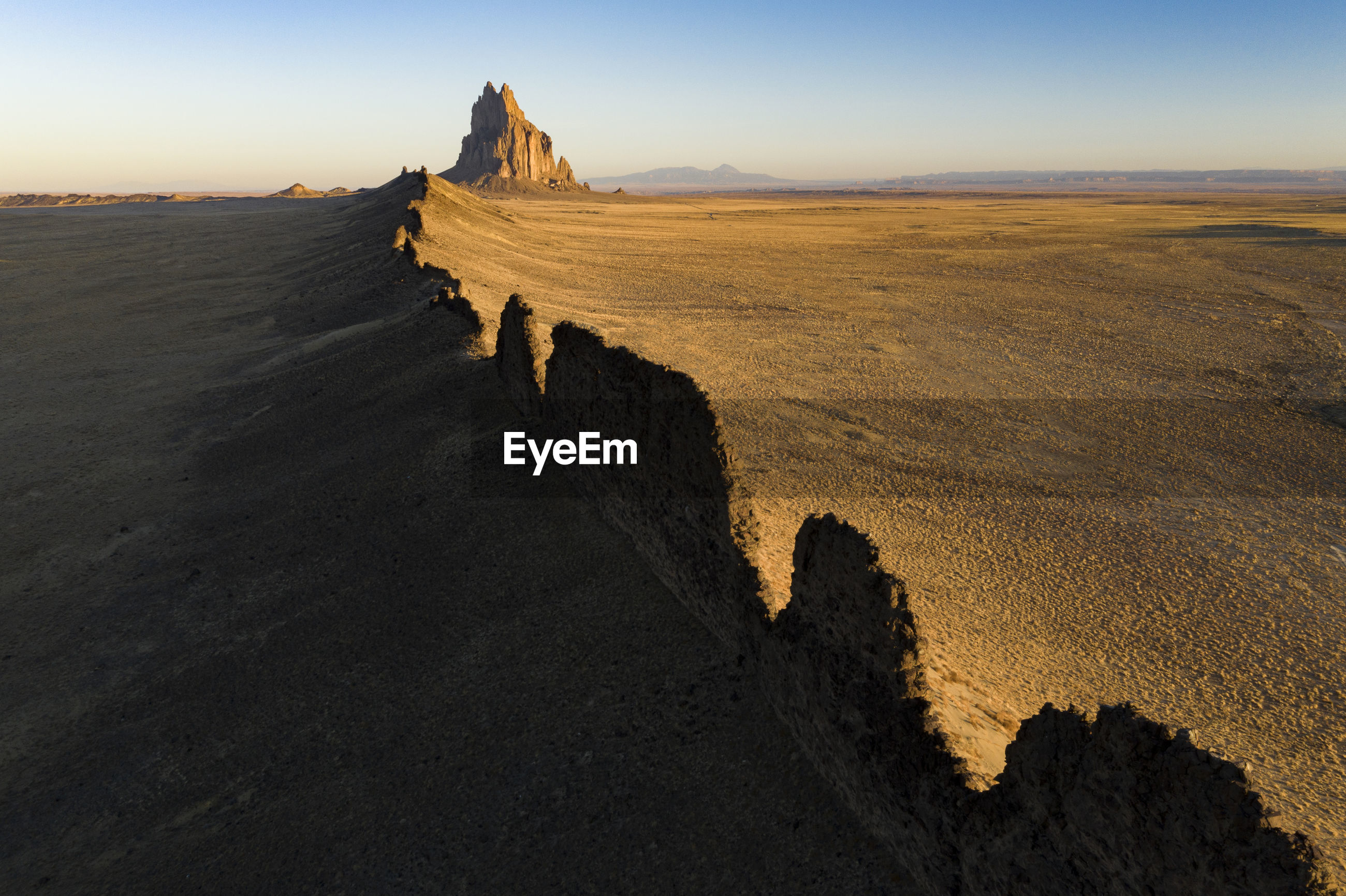 PANORAMIC VIEW OF DESERT LAND AGAINST SKY