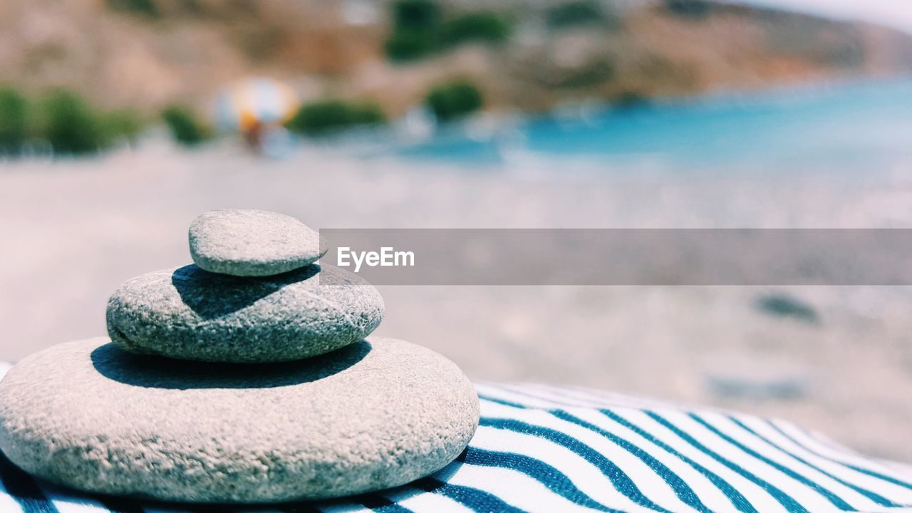 focus on foreground, balance, outdoors, day, water, pebble, no people, sea, sand, close-up, nature, stack, beauty in nature, sky
