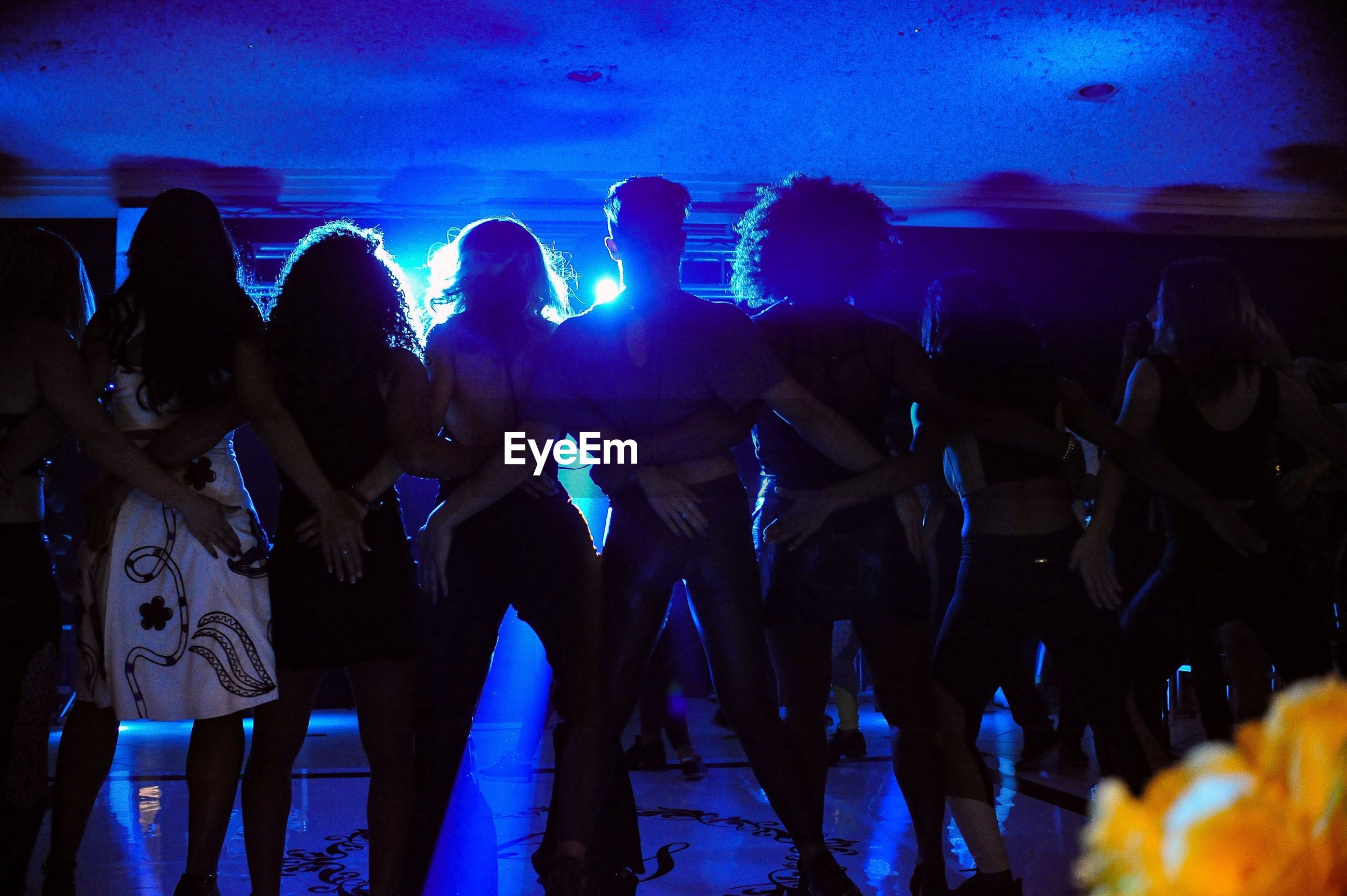 Rear view of people dancing in party