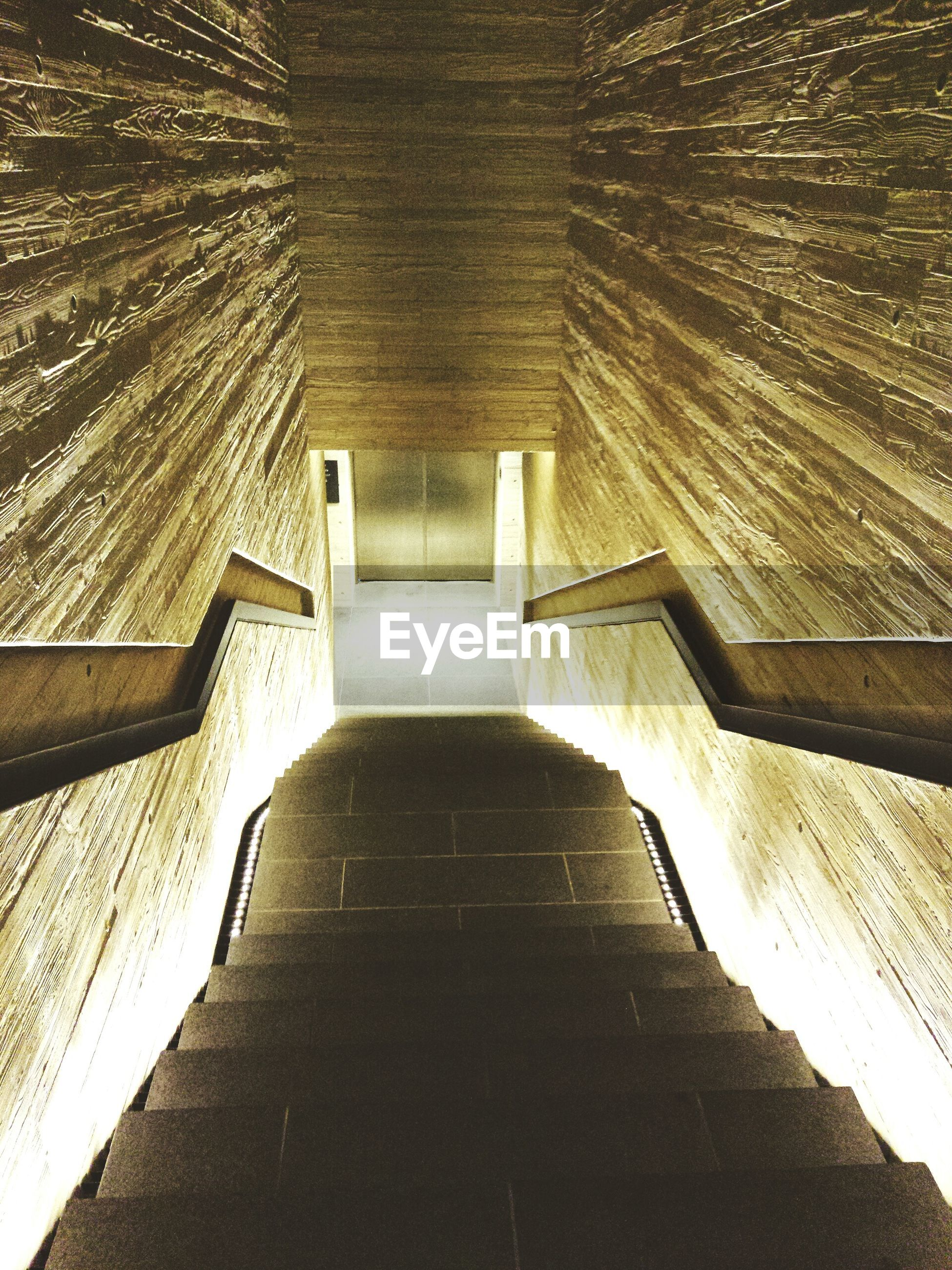 architecture, built structure, the way forward, steps, building exterior, steps and staircases, staircase, diminishing perspective, building, narrow, railing, low angle view, wall - building feature, walkway, sunlight, shadow, no people, leading, vanishing point, indoors