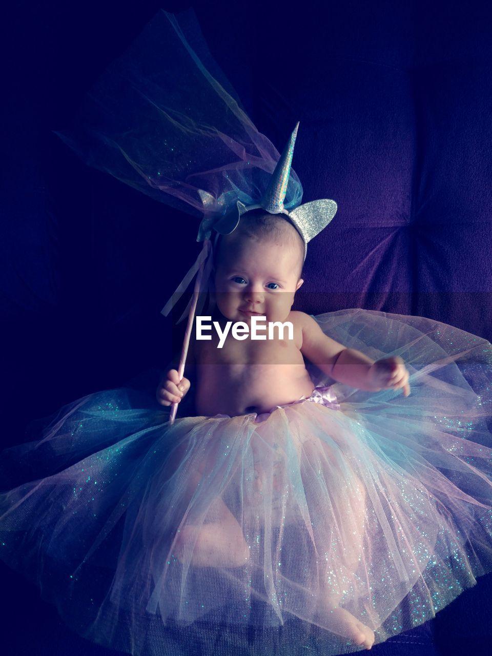 Portrait of cute baby girl wearing tutu