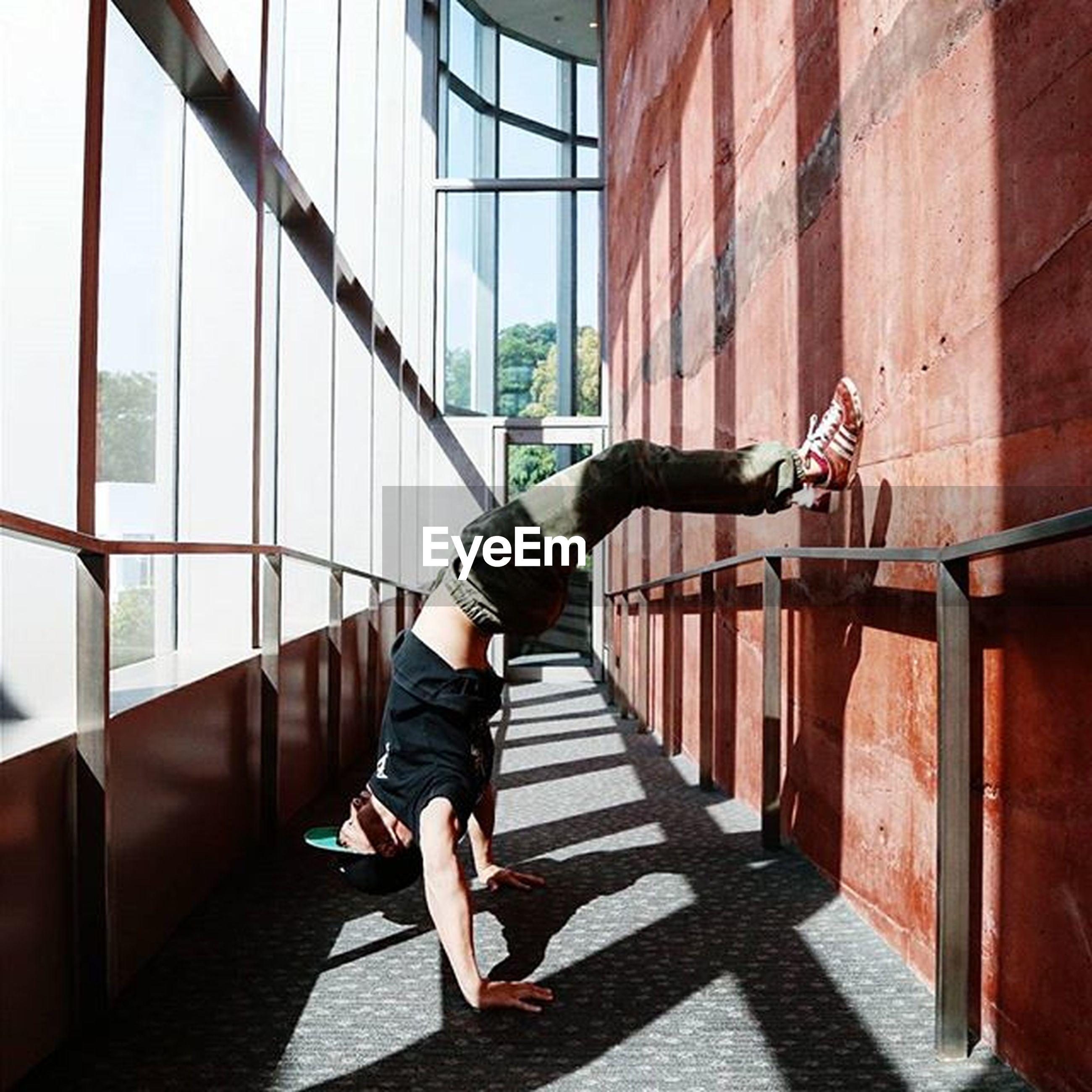 full length, architecture, built structure, lifestyles, railing, building exterior, steps, casual clothing, walking, men, leisure activity, rear view, staircase, steps and staircases, standing, building, person, modern