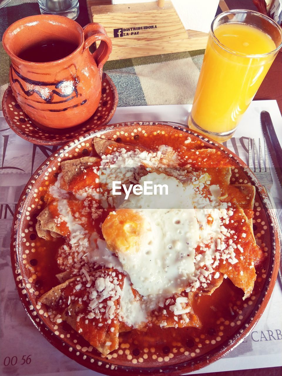 food and drink, food, table, drink, plate, serving size, breakfast, ready-to-eat, freshness, indoors, refreshment, healthy eating, drinking glass, meal, no people, orange juice, tea - hot drink, fried egg, temptation, close-up, gourmet, egg yolk, day