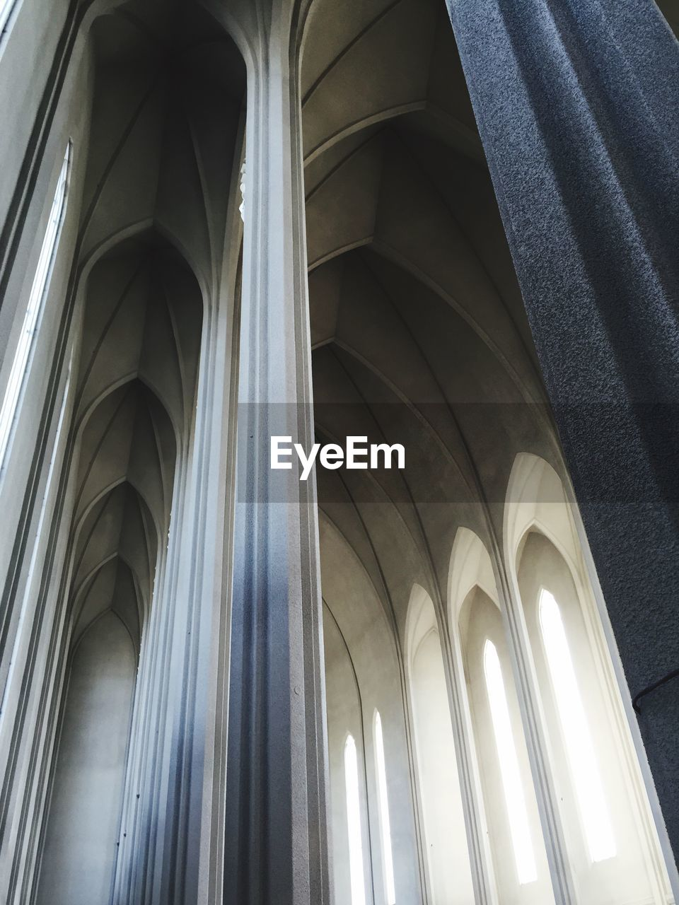 architecture, arch, low angle view, built structure, architectural column, no people, indoors, day, place of worship, close-up