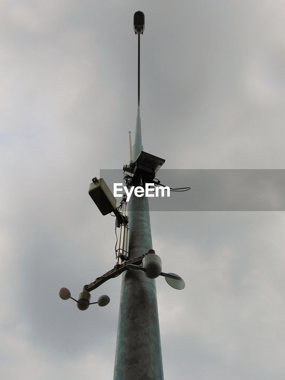 sky, low angle view, cloud - sky, no people, technology, lighting equipment, day, nature, pole, street, street light, outdoors, security camera, protection, vertebrate, security, bird, surveillance, communication, animals in the wild, light