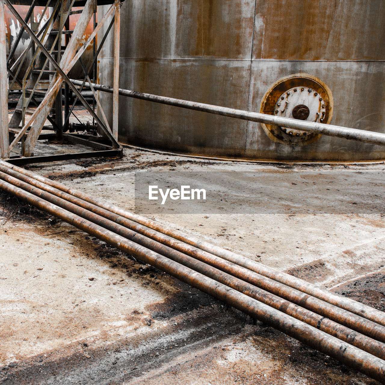 metal, no people, water, day, architecture, pipe - tube, built structure, outdoors, pipe, water pipe, industry, wall - building feature, close-up, hose, nature, flowing water, focus on foreground, wood - material, dirt, garden hose, running water