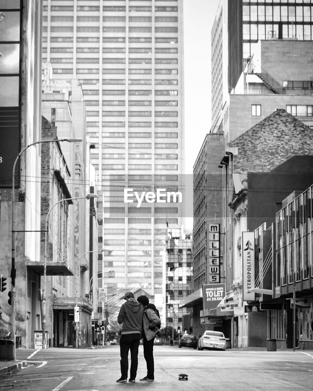 Friends Standing On Street In City