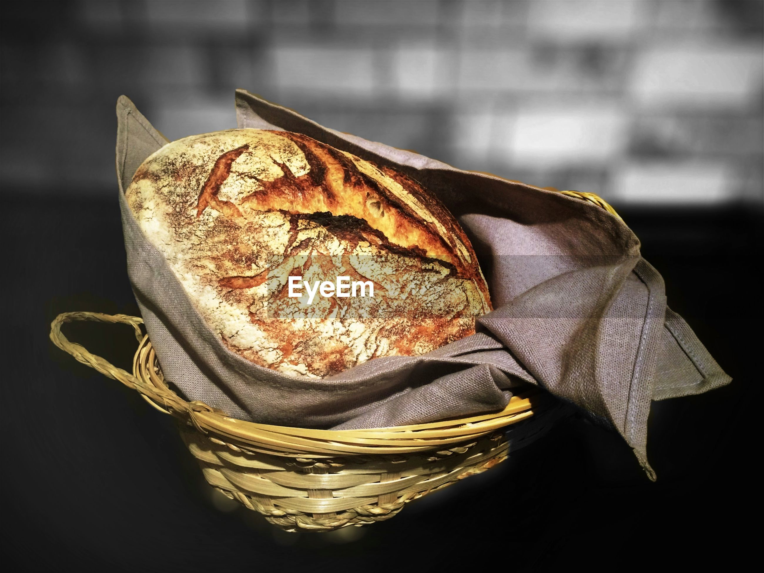 High angle view of bread and napkin in wicker basket