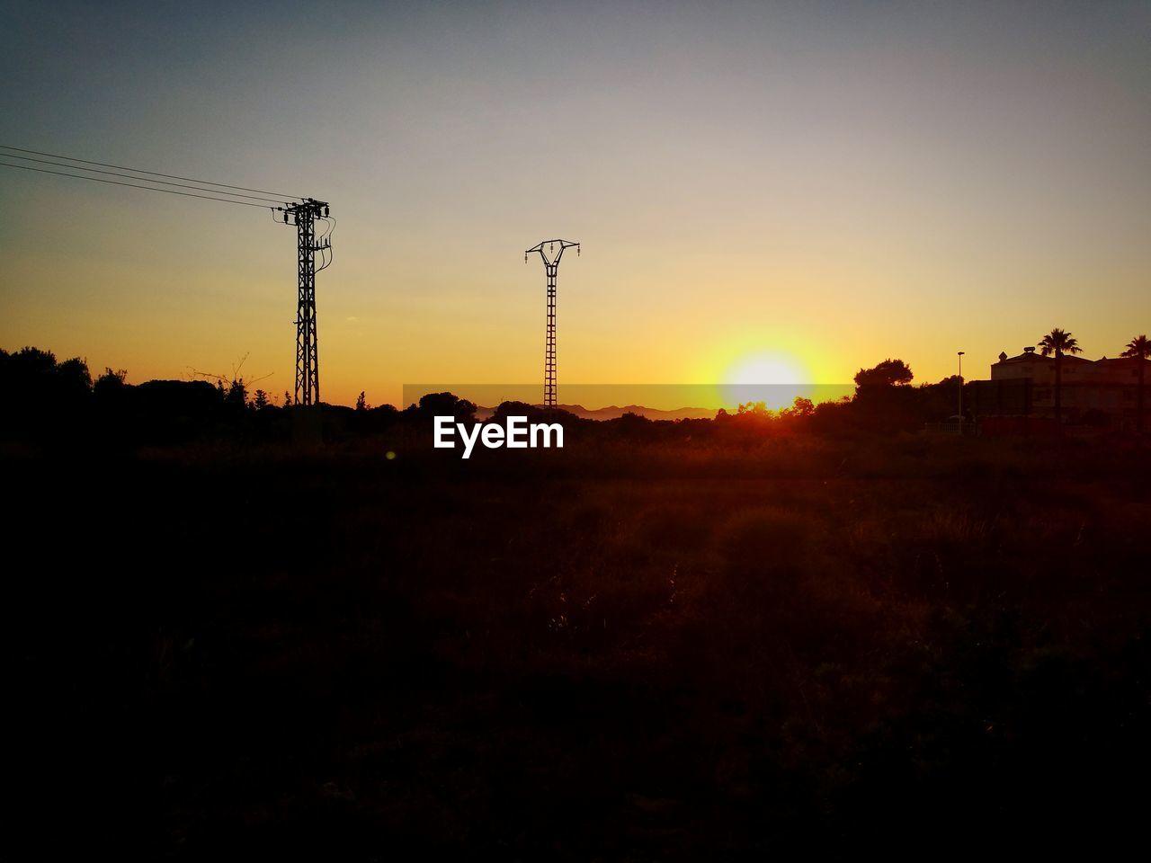 sky, sunset, electricity, electricity pylon, silhouette, nature, technology, orange color, cable, sun, environment, no people, power line, landscape, outdoors, land, power supply, copy space, architecture, built structure