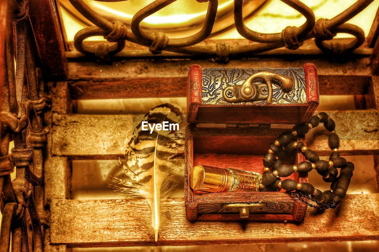 metal, ornate, no people, gold colored, sculpture, close-up, day, indoors