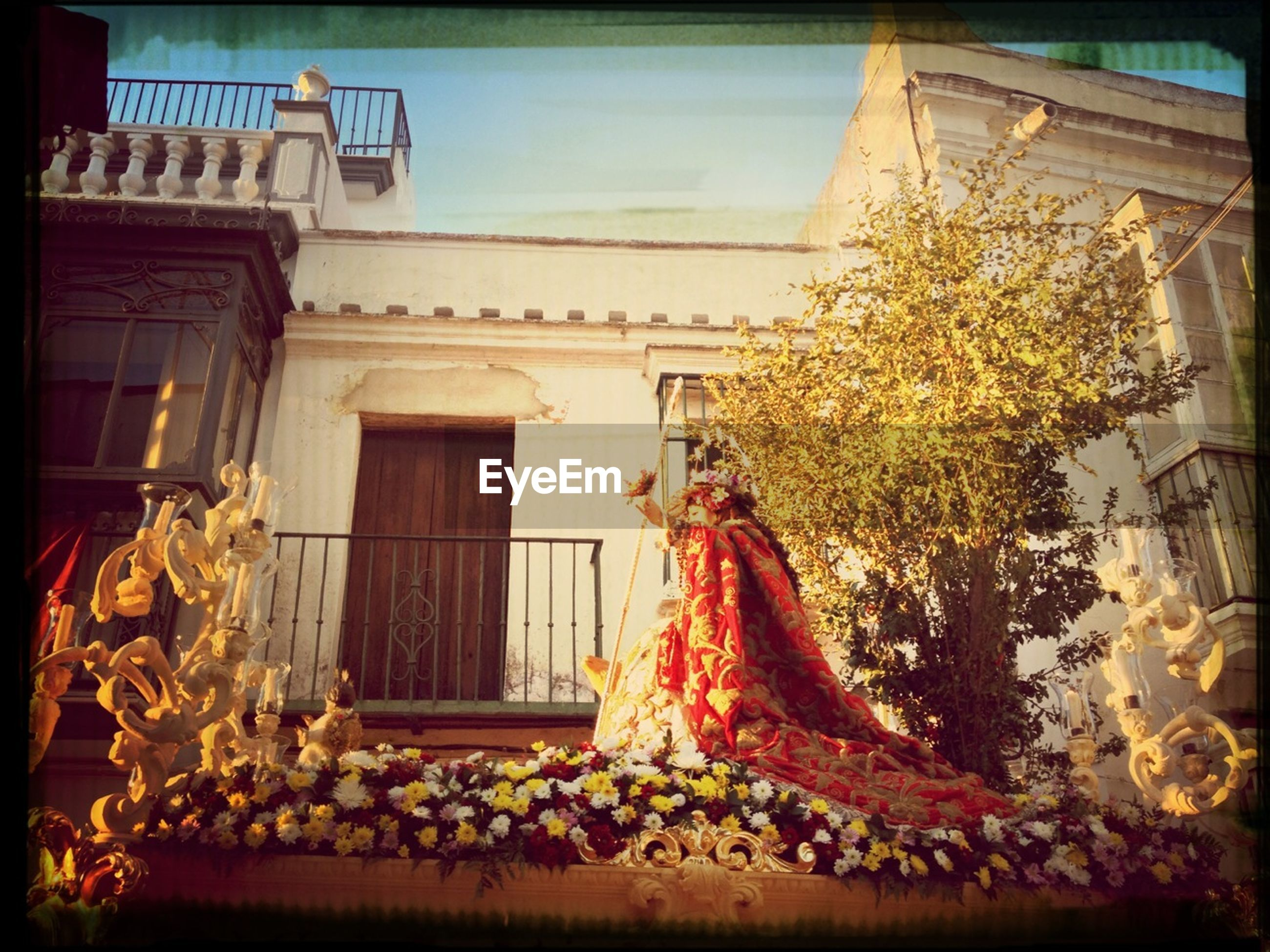 transfer print, building exterior, built structure, architecture, auto post production filter, flower, window, house, plant, low angle view, statue, potted plant, day, sculpture, outdoors, no people, residential structure, sunlight, front or back yard, growth