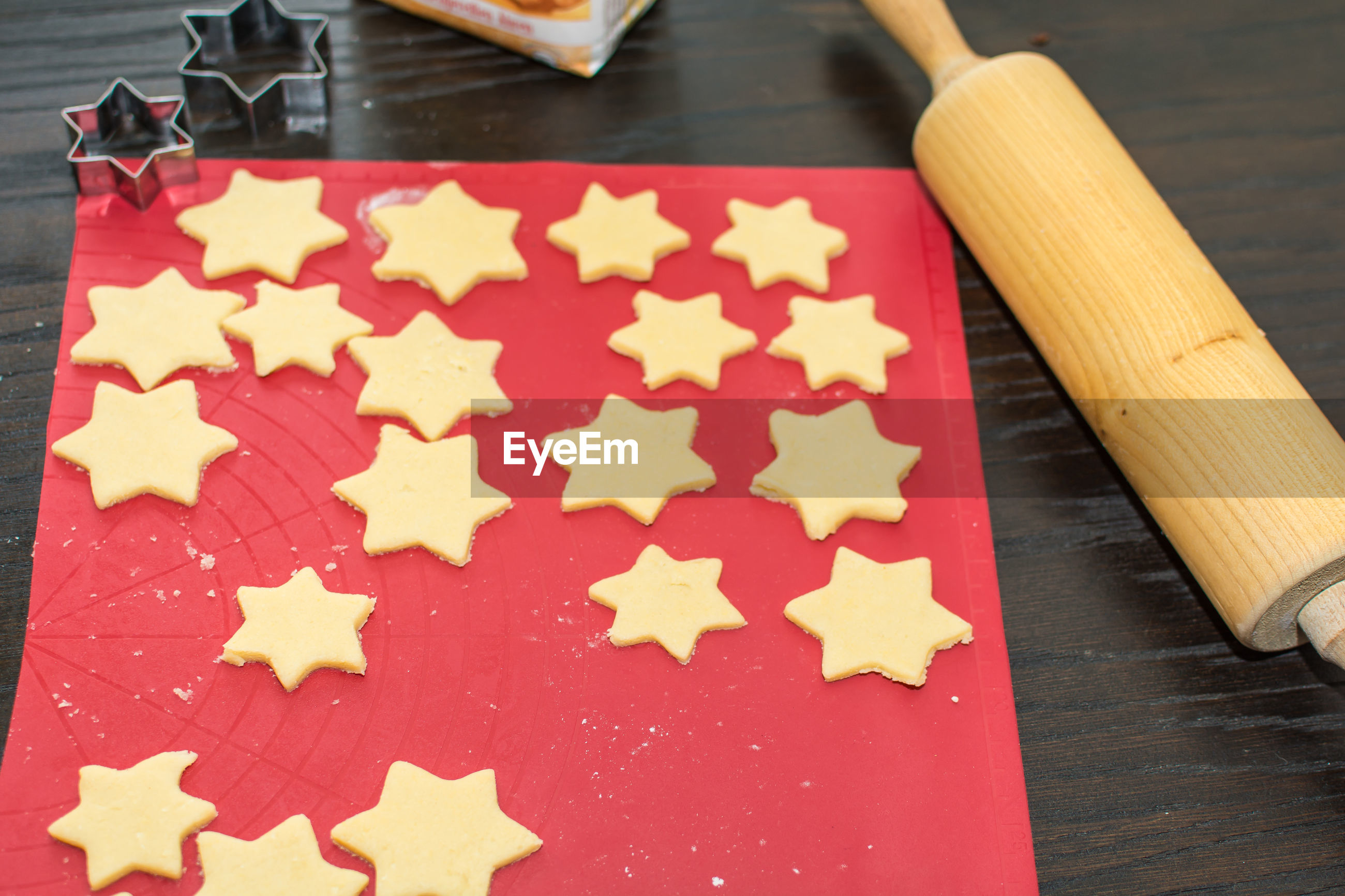 Baking christmas cookies in star form for advent season