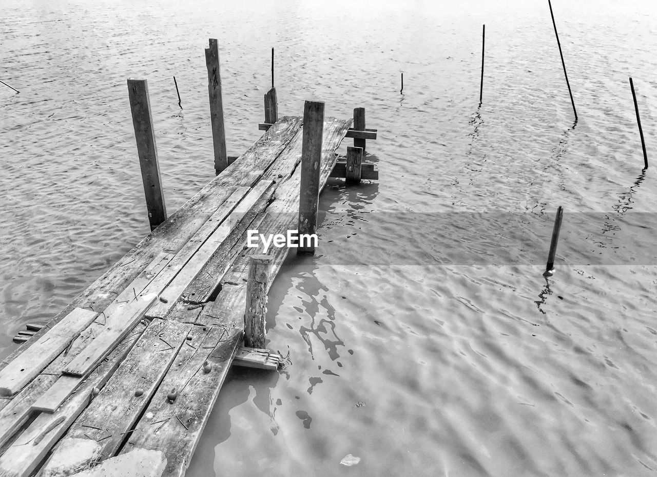 wood - material, water, high angle view, pier, outdoors, day, no people, nature, winter, wooden post, sea, nautical vessel