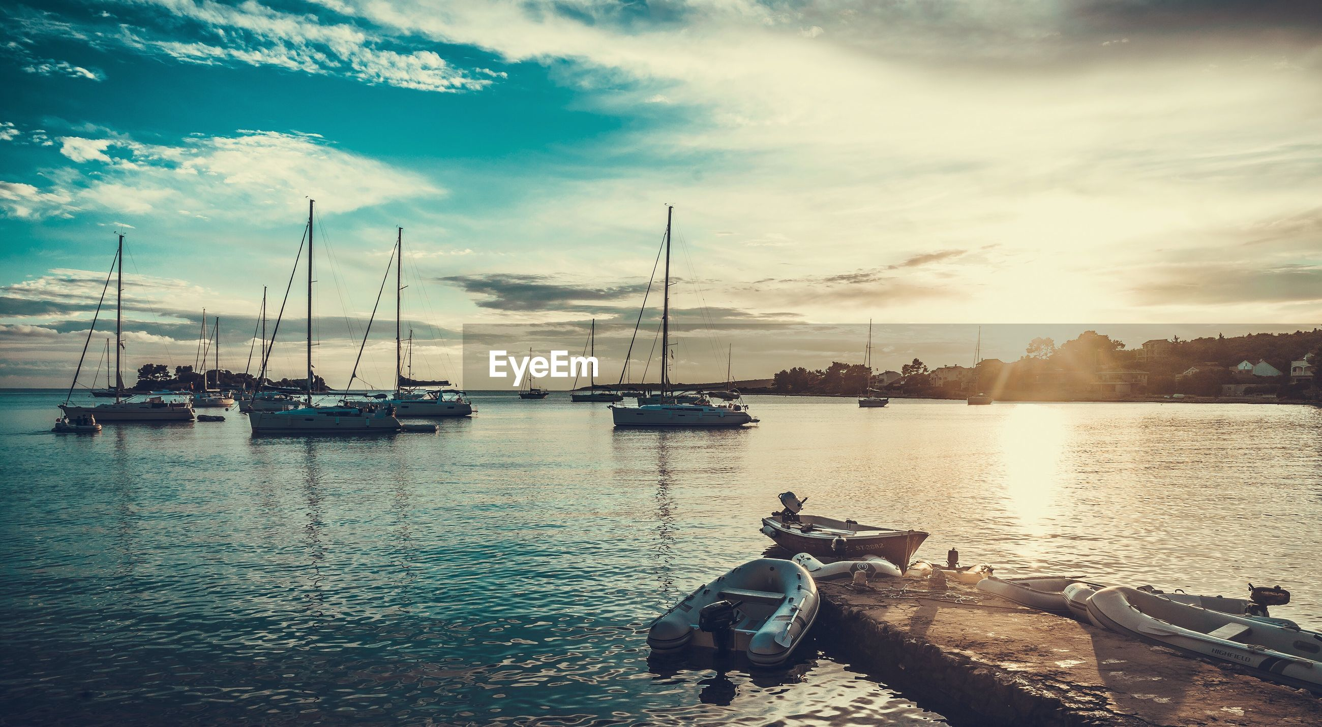 nautical vessel, transportation, boat, water, mode of transport, cloud, calm, sunlight, sky, moored, ocean, sun, sunbeam, sea, tranquility, tranquil scene, day, cloud - sky, nature, bright, harbor, lens flare, waterfront, scenics, no people, horizon over land