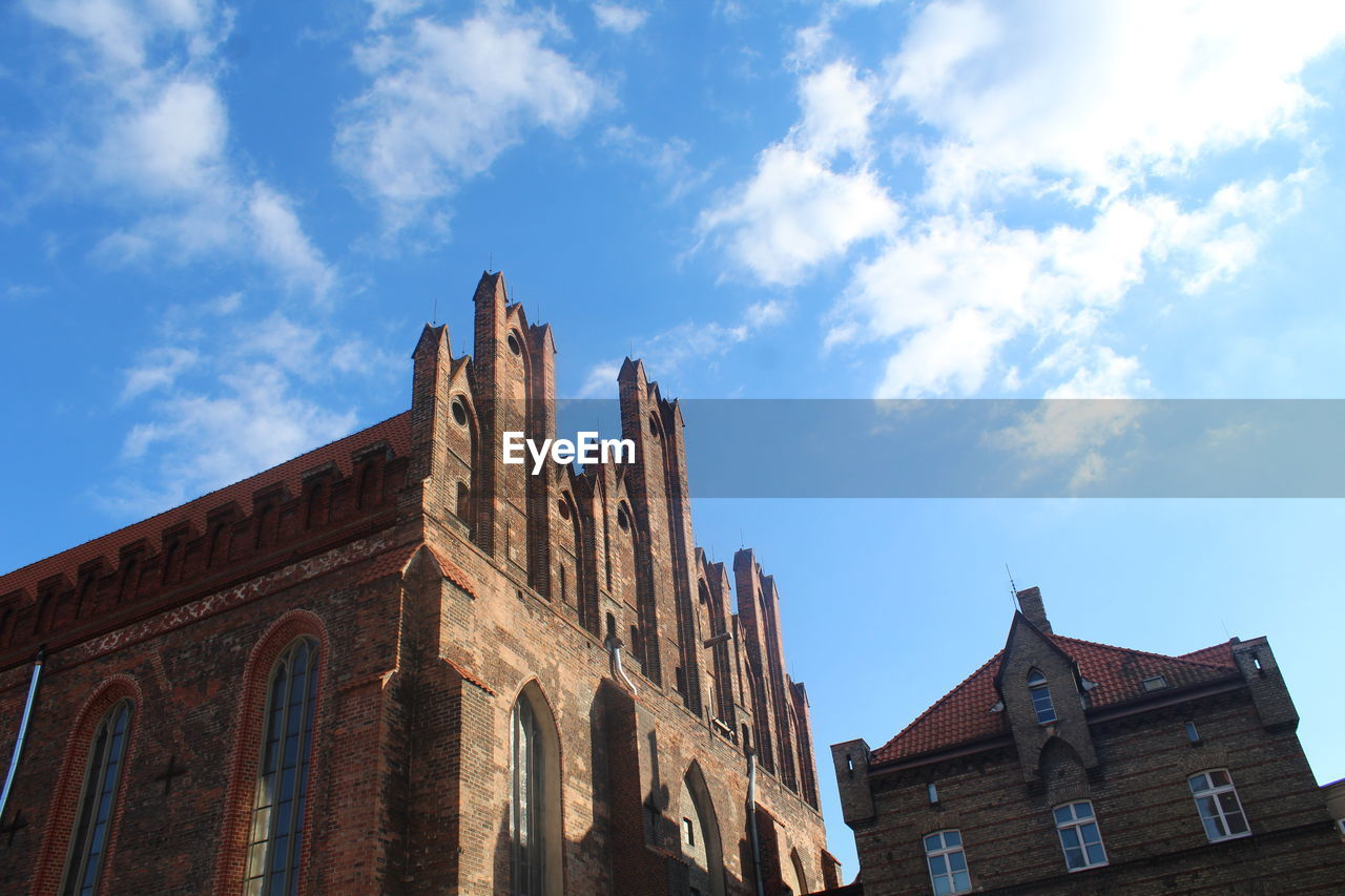 Low angle view of historic church against sky