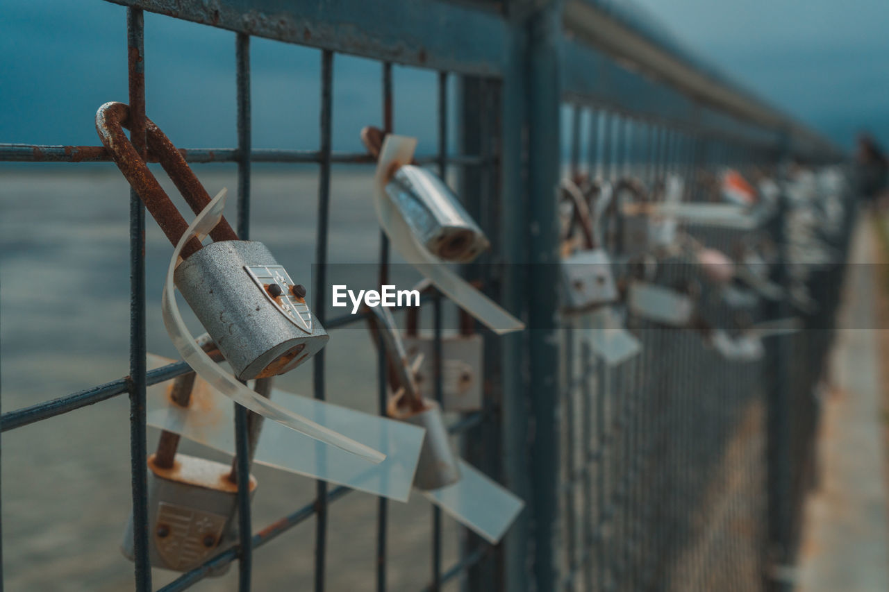metal, lock, padlock, hanging, railing, day, protection, no people, safety, security, focus on foreground, selective focus, bridge, nature, outdoors, built structure, bridge - man made structure, love, positive emotion, fence