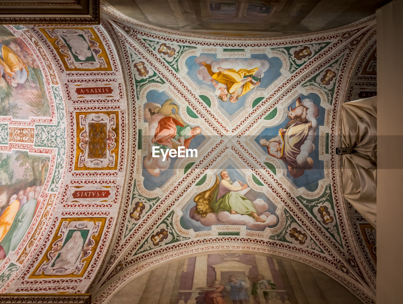 art and craft, pattern, indoors, architecture, ceiling, design, built structure, low angle view, craft, no people, creativity, religion, travel destinations, building, the past, mural, belief, place of worship, tourism, ornate, directly below, architecture and art