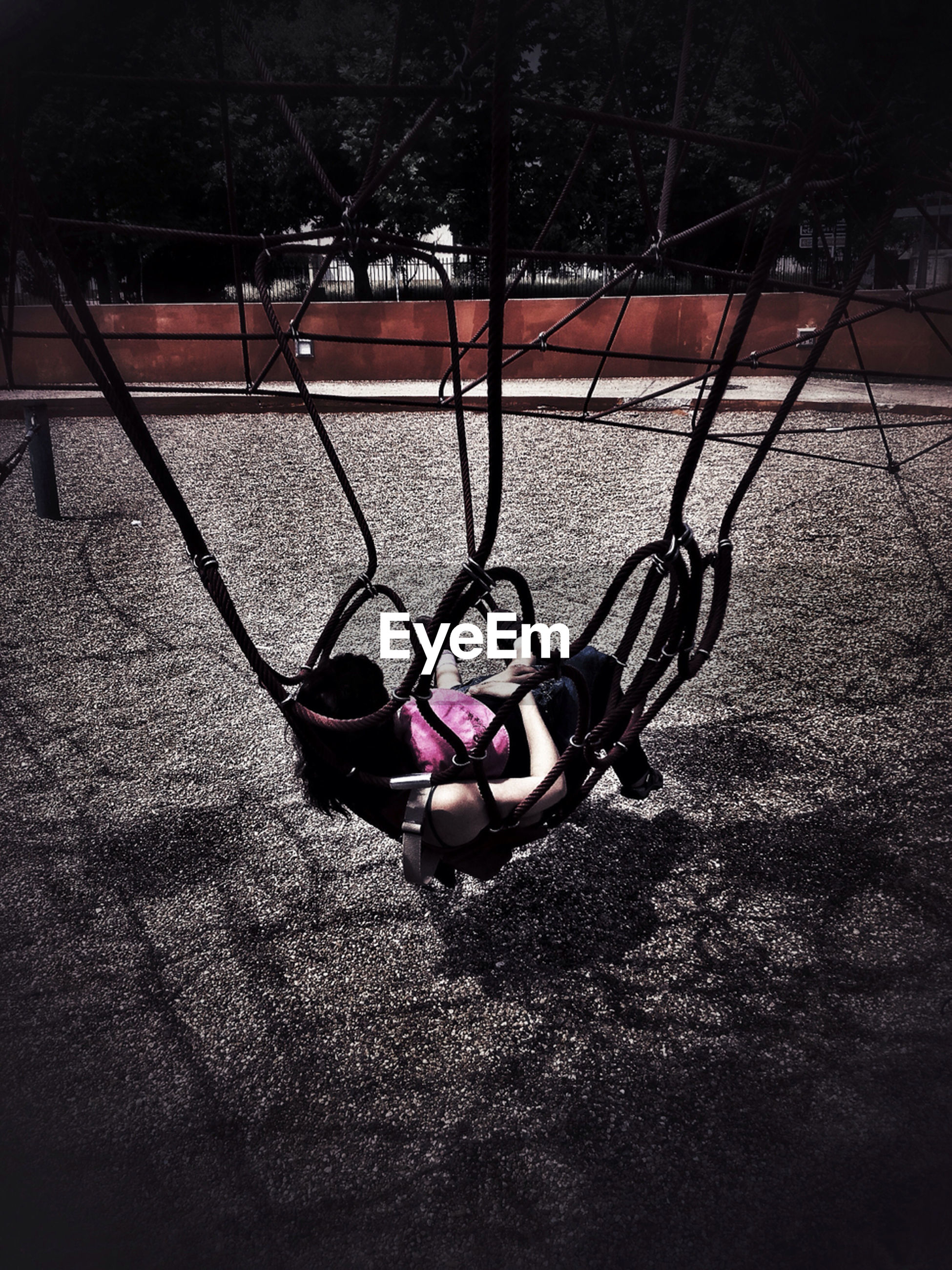 childhood, playground, shadow, high angle view, toy, bicycle, absence, outdoors, sport, bare tree, street, still life, no people, day, transportation, multi colored, hanging, swing, sunlight, grass