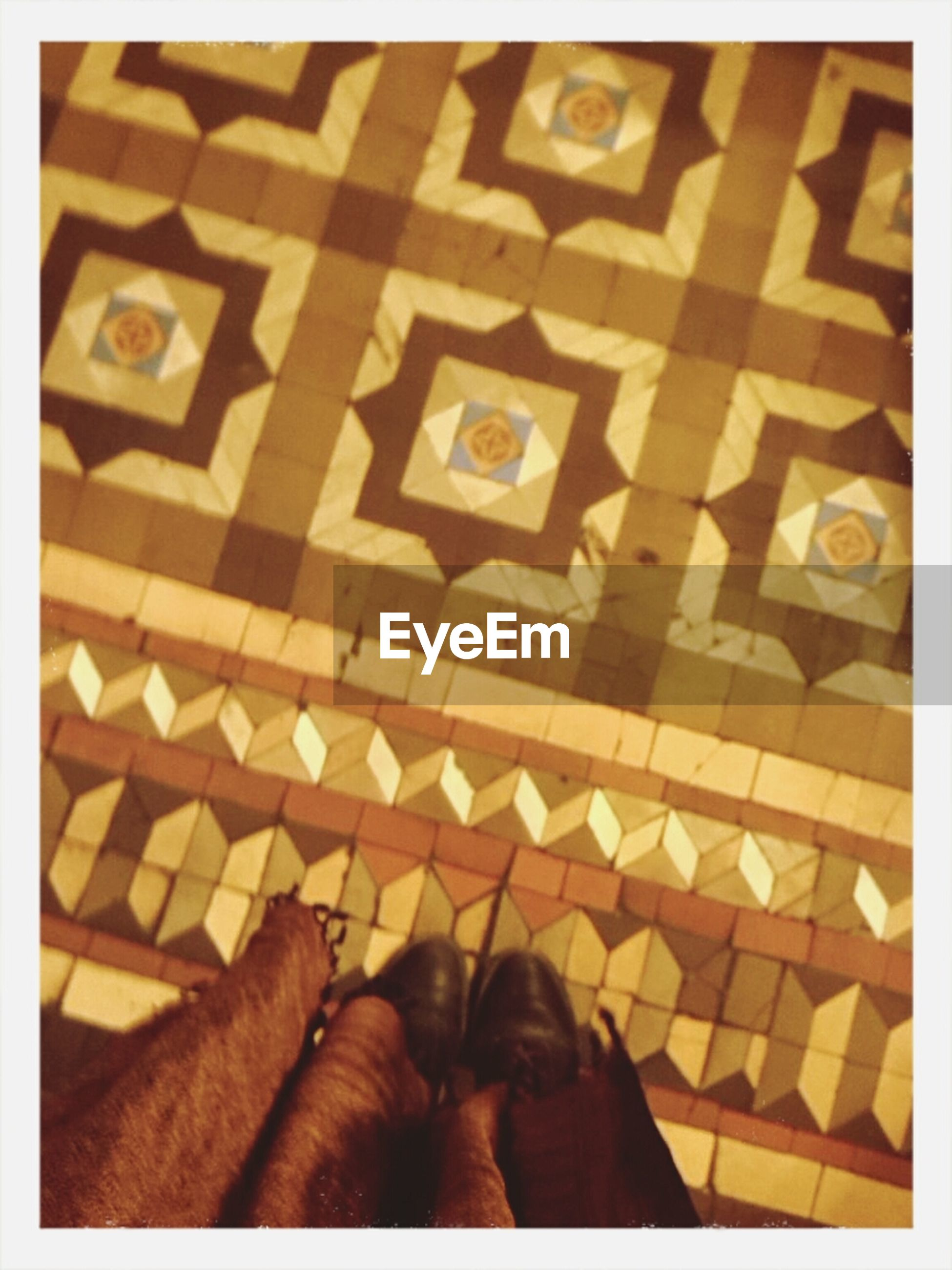 transfer print, personal perspective, low section, person, auto post production filter, indoors, high angle view, lifestyles, human foot, unrecognizable person, part of, men, shoe, leisure activity, standing, flooring
