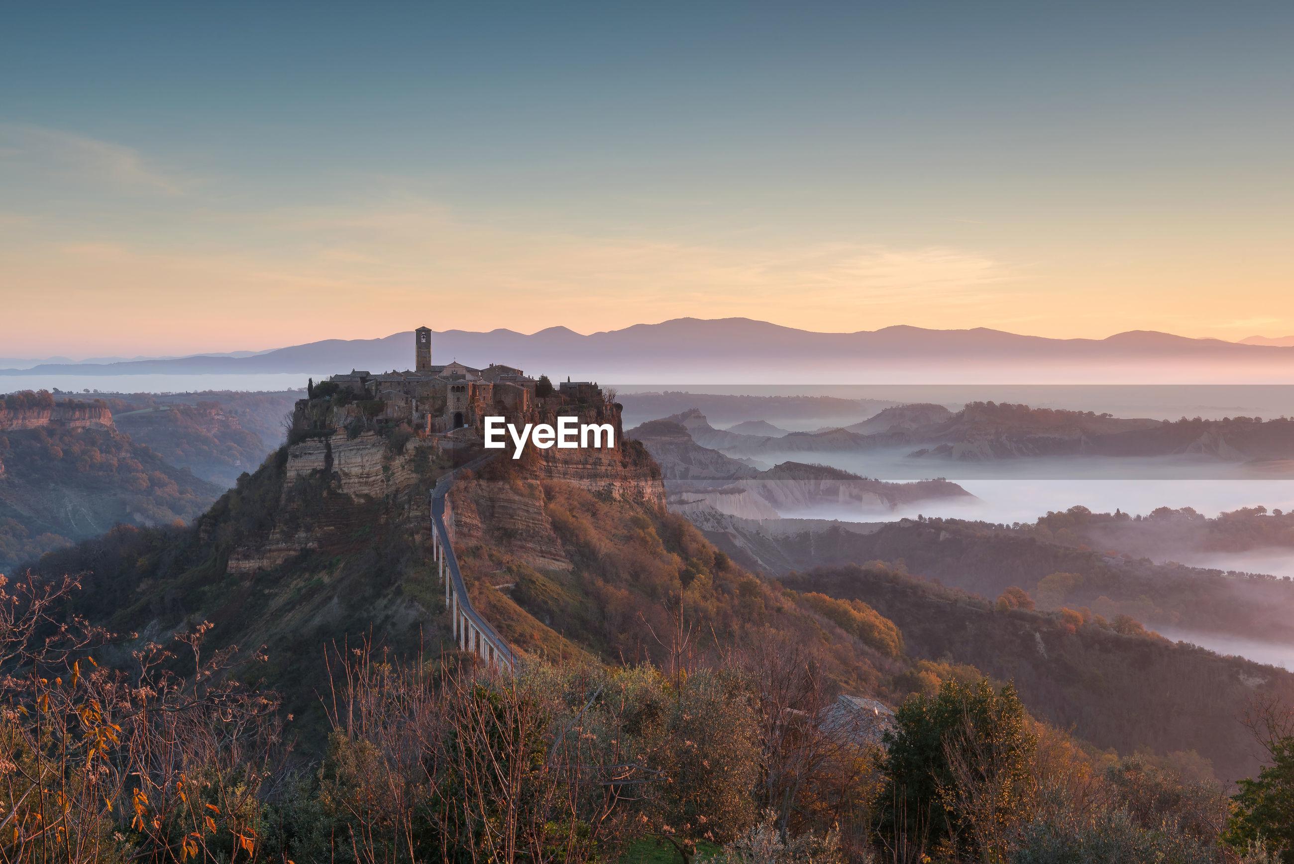 Scenic view of town on mountain peak