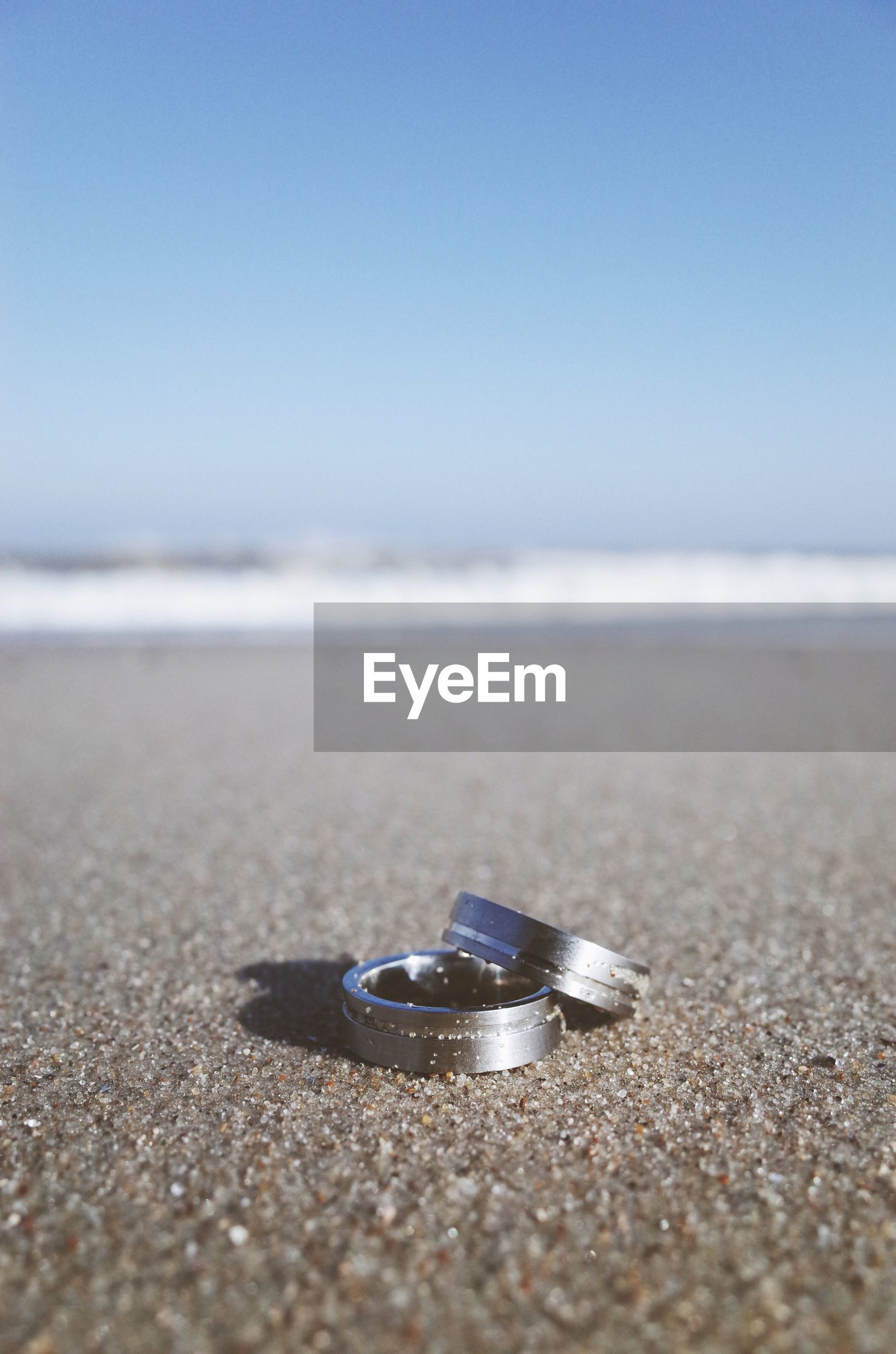 Close-up of rings on beach