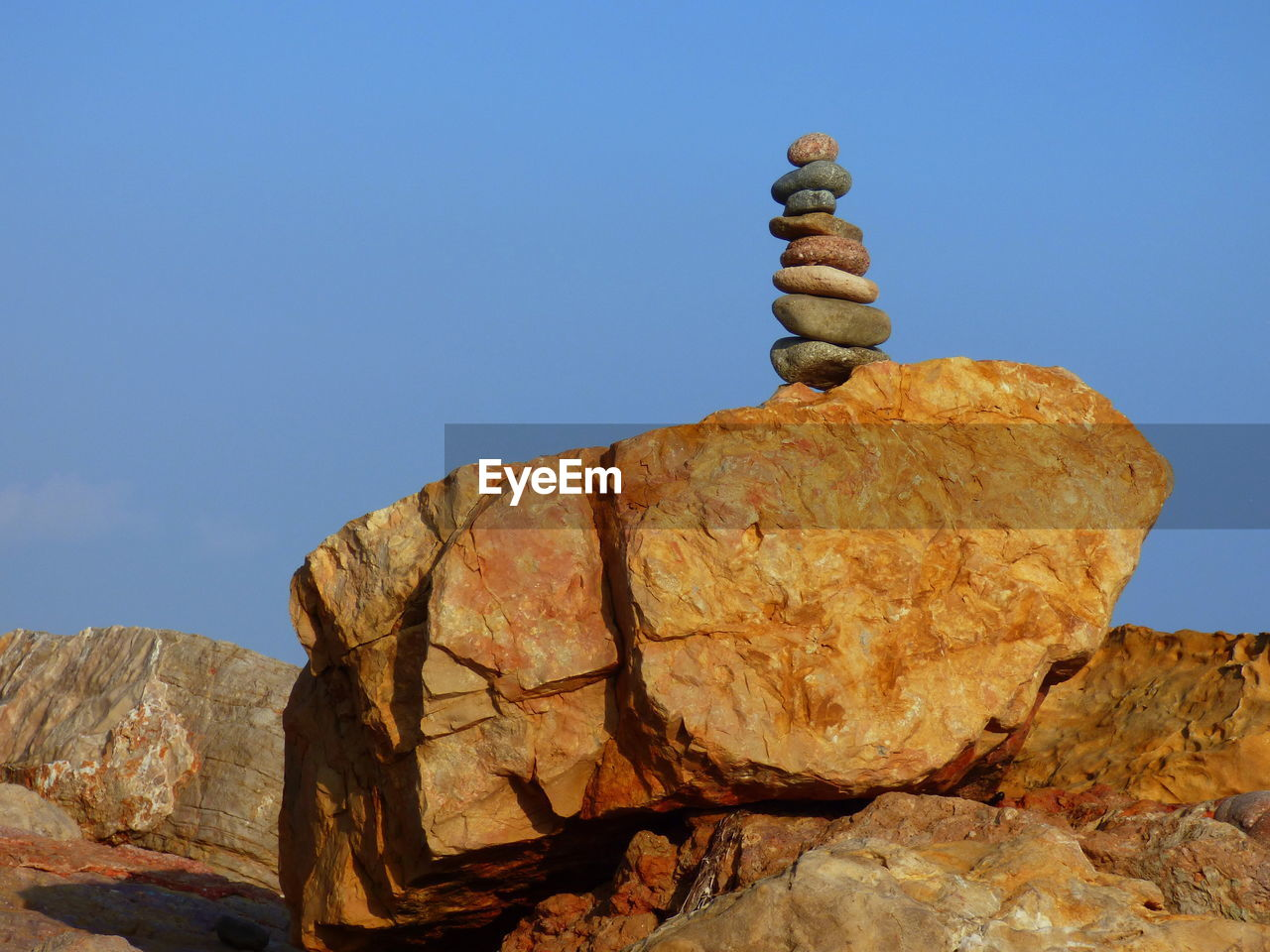 rock - object, clear sky, rock formation, geology, nature, balance, tranquility, day, blue, no people, outdoors, beauty in nature, mountain, sky