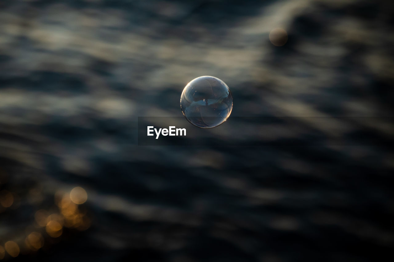 Close-up of bubbles against sea