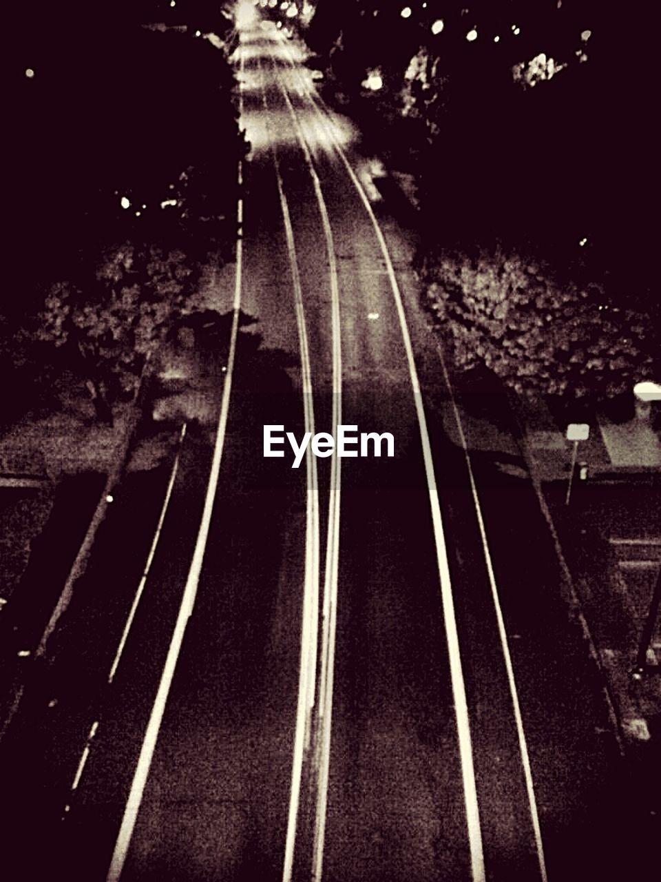 transportation, motion, night, long exposure, no people, speed, outdoors, railroad track, illuminated, nature