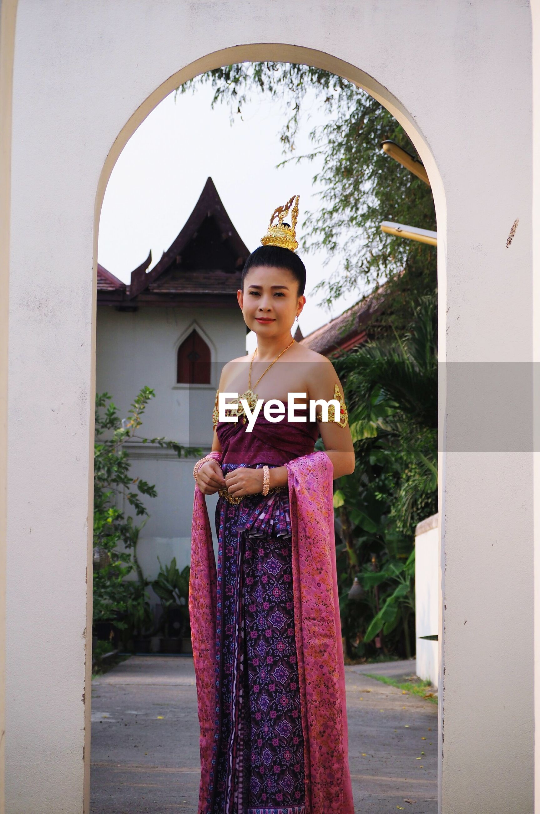Woman in traditional clothing standing at entrance