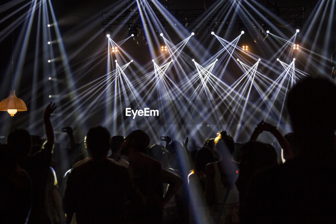 Large Group Of People Enjoying Music Concert