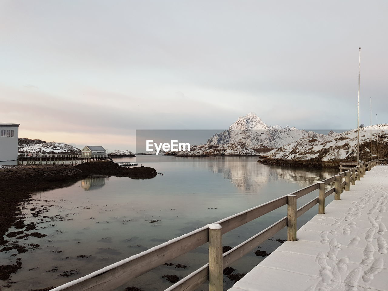 water, sky, scenics - nature, nature, cold temperature, beauty in nature, no people, railing, tranquil scene, cloud - sky, tranquility, architecture, snow, winter, built structure, day, outdoors, sea, snowcapped mountain