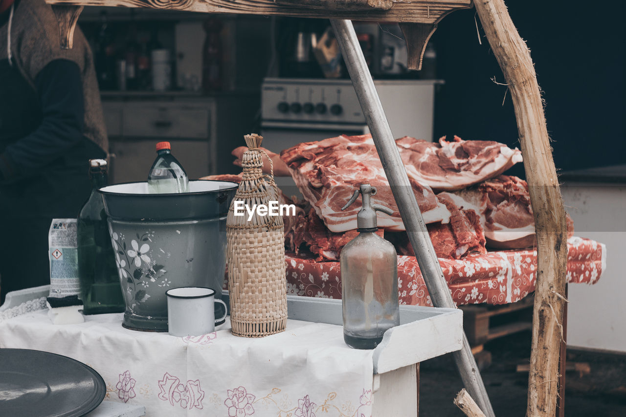 food, food and drink, meat, freshness, outdoors, day, real people, ice cream, close-up, butcher