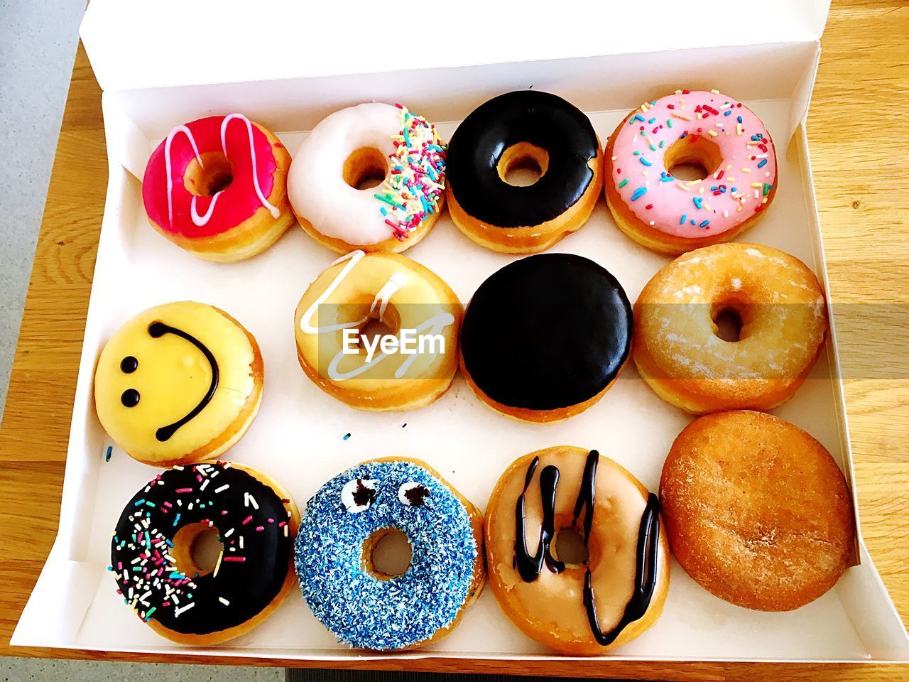food and drink, food, indulgence, sweet food, temptation, still life, ready-to-eat, dessert, freshness, variation, table, directly above, donut, unhealthy eating, no people, indoors, sprinkles, serving size, plate, high angle view, multi colored, choice, close-up, day