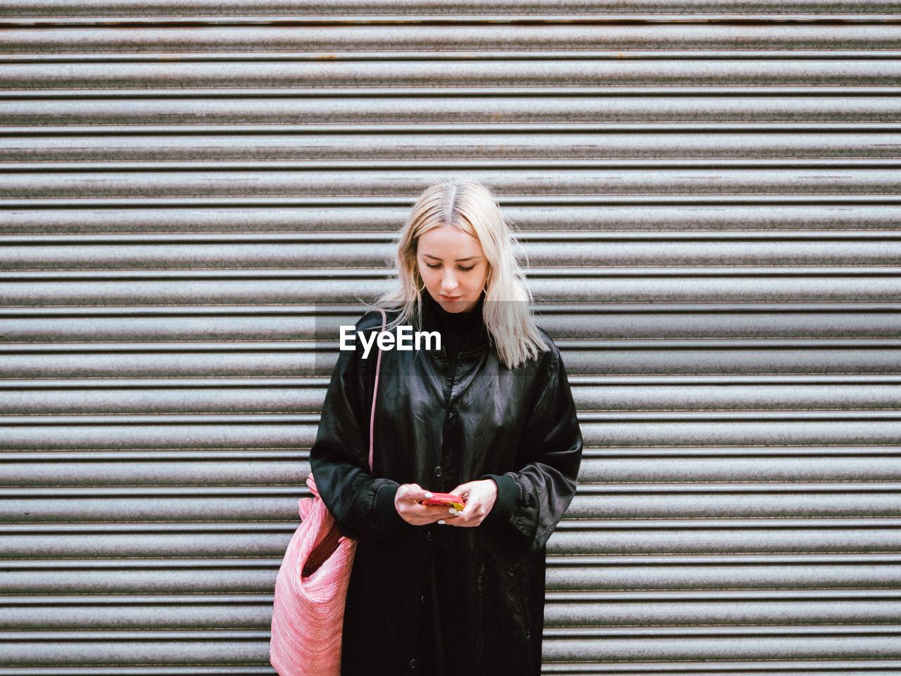 Woman Against Door